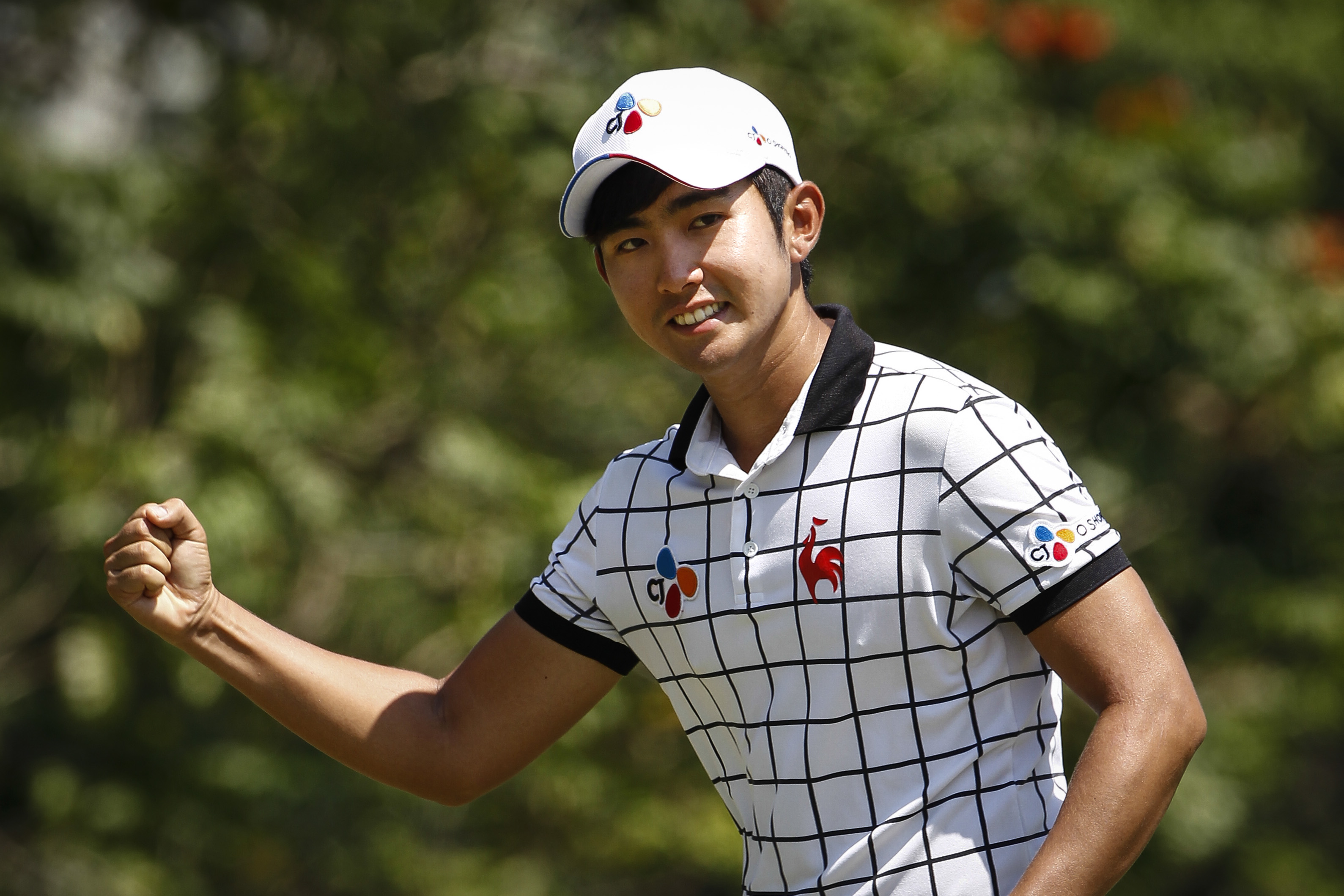 Lee Soo-min of South Korea celebrates after sinking in a birdie putt on the seventh hole during the final round of the Maybank Championship golf tournament in Kuala Lumpur, Malaysia, on Sunday, Feb. 21, 2016. (AP Photo/Joshua Paul)