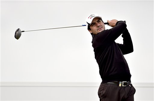 Felipe Aguilar from Chile plays a tee shot during the first round of the Made in Denmark golf tournament, in Himmerland, Denmark, Thursday, Aug. 14, 2014. (AP Photo/Polfoto, Rene Schutze) DENMARK OUT