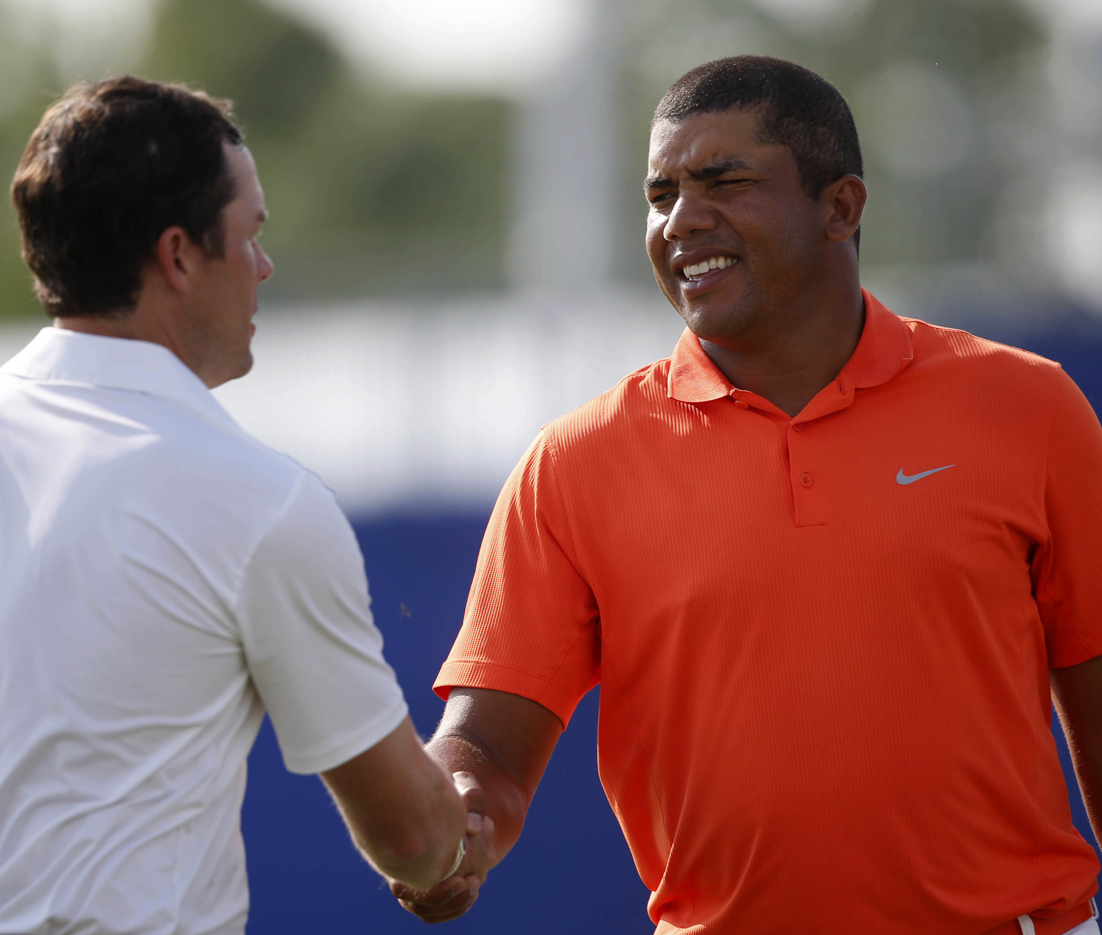Jhonattan Vegas, right, of Venezuela, shakes hands with Kyle Reifers, left, after finishing the day on the ninth hole during the second round of the PGA Zurich Classic golf tournament at TPC Louisiana in Avondale, La., Friday, April 29, 2016. (AP Photo/Ge