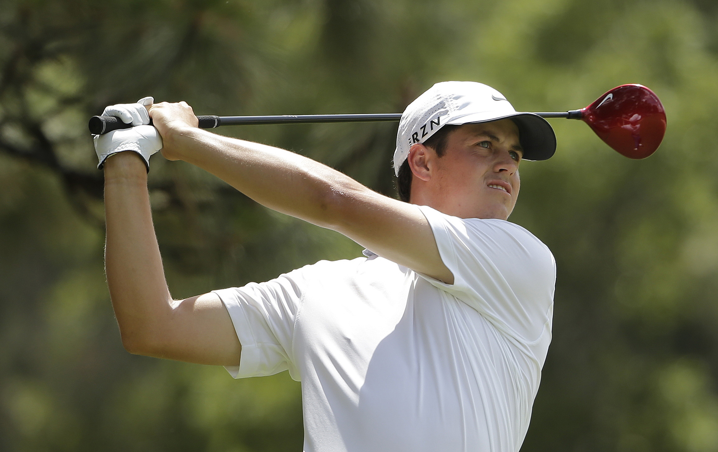 Cody Gribble watches his tee shot on the second hole during the first round of the U.S. Open golf tournament in Pinehurst, N.C., Thursday, June 12, 2014. (AP Photo/Chuck Burton)