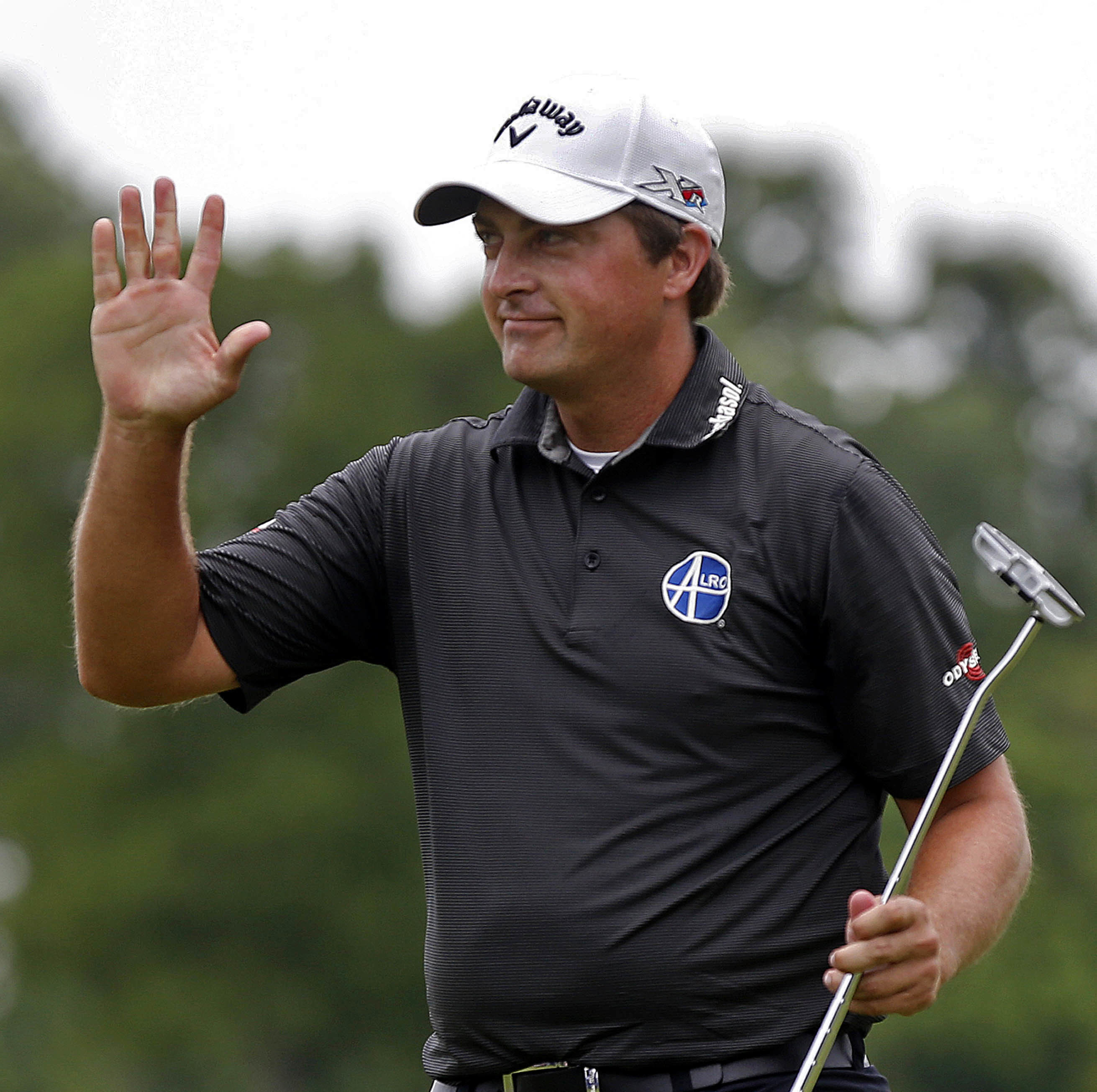 Brian Stuard waves after sinking his putt on the 18th green during a playoff round to win the rain-delayed Zurich Classic golf tournament at TPC Louisiana in Avondale, La., Monday, May 2, 2016.  (AP Photo/Gerald Herbert)