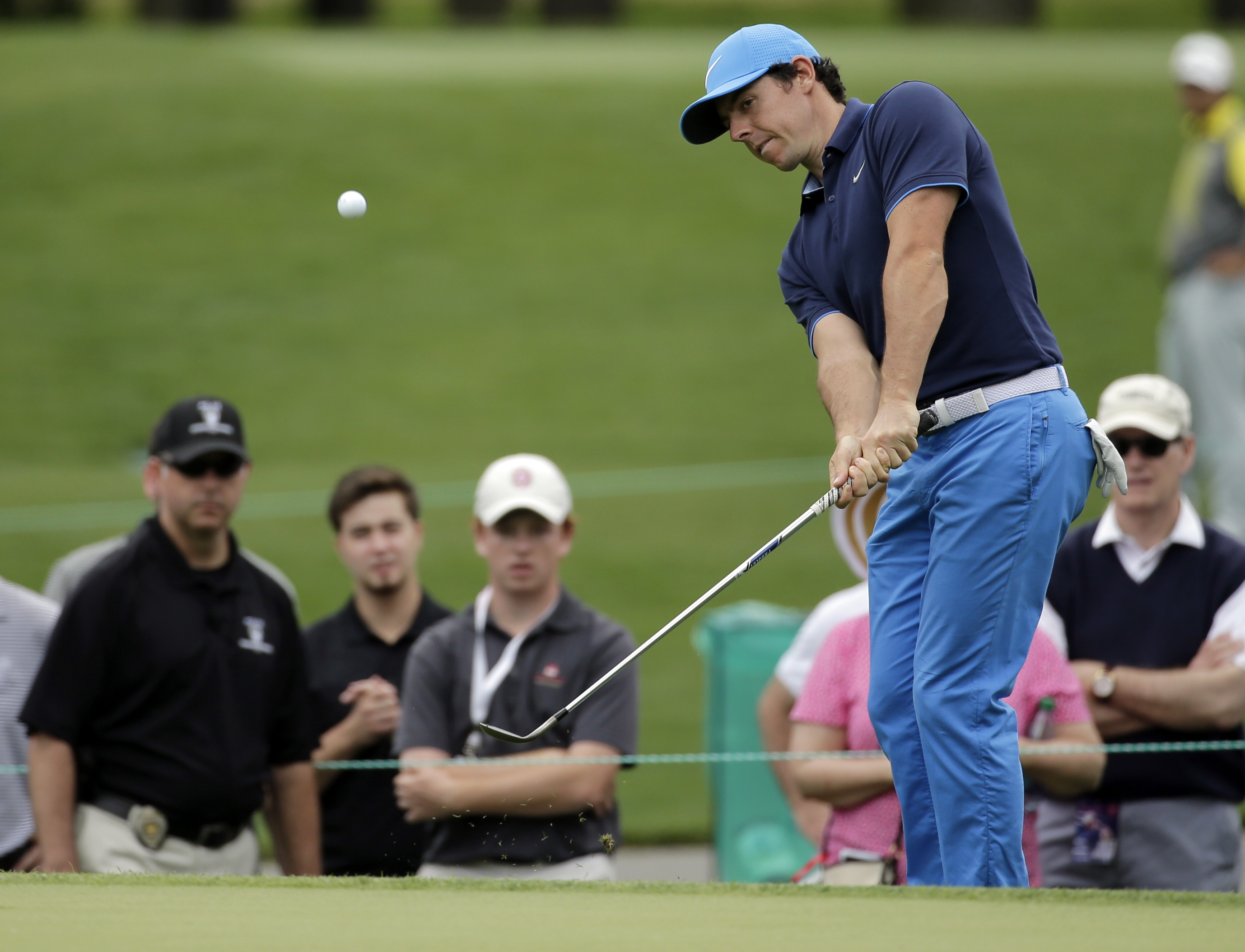 Rory McIlroy chips to the second green during the pro-am of the Wells Fargo Championship golf tournament at Quail Hollow Club in Charlotte, N.C., Wednesday, May 4, 2016. (AP Photo/Chuck Burton)