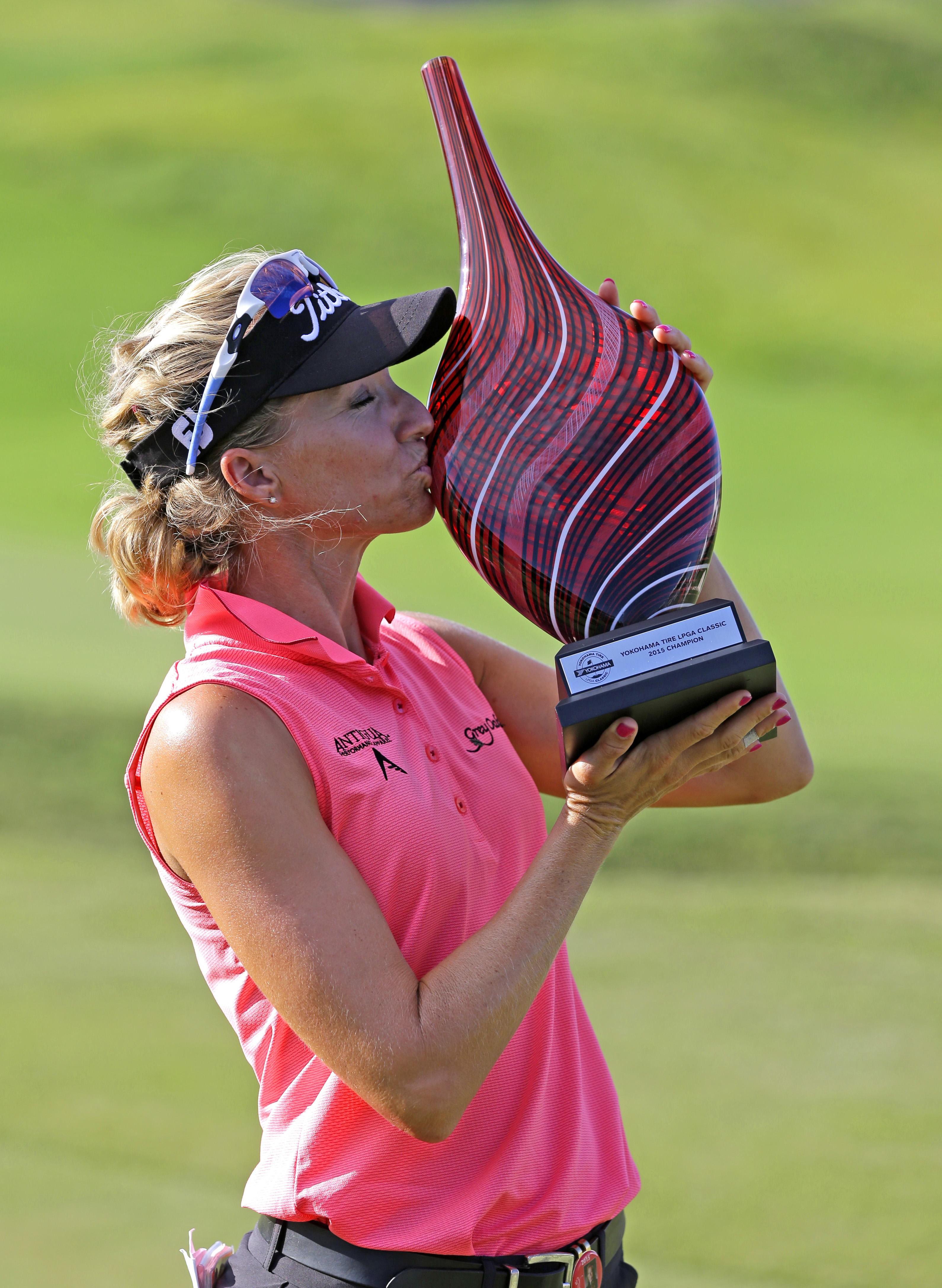 Kris Tamulis kisses the trophy after winning the Yokohama Tire LPGA Classic golf tournament, Sunday, Aug. 30, 2015, in Prattville, Ala. (AP Photo/Butch Dill)