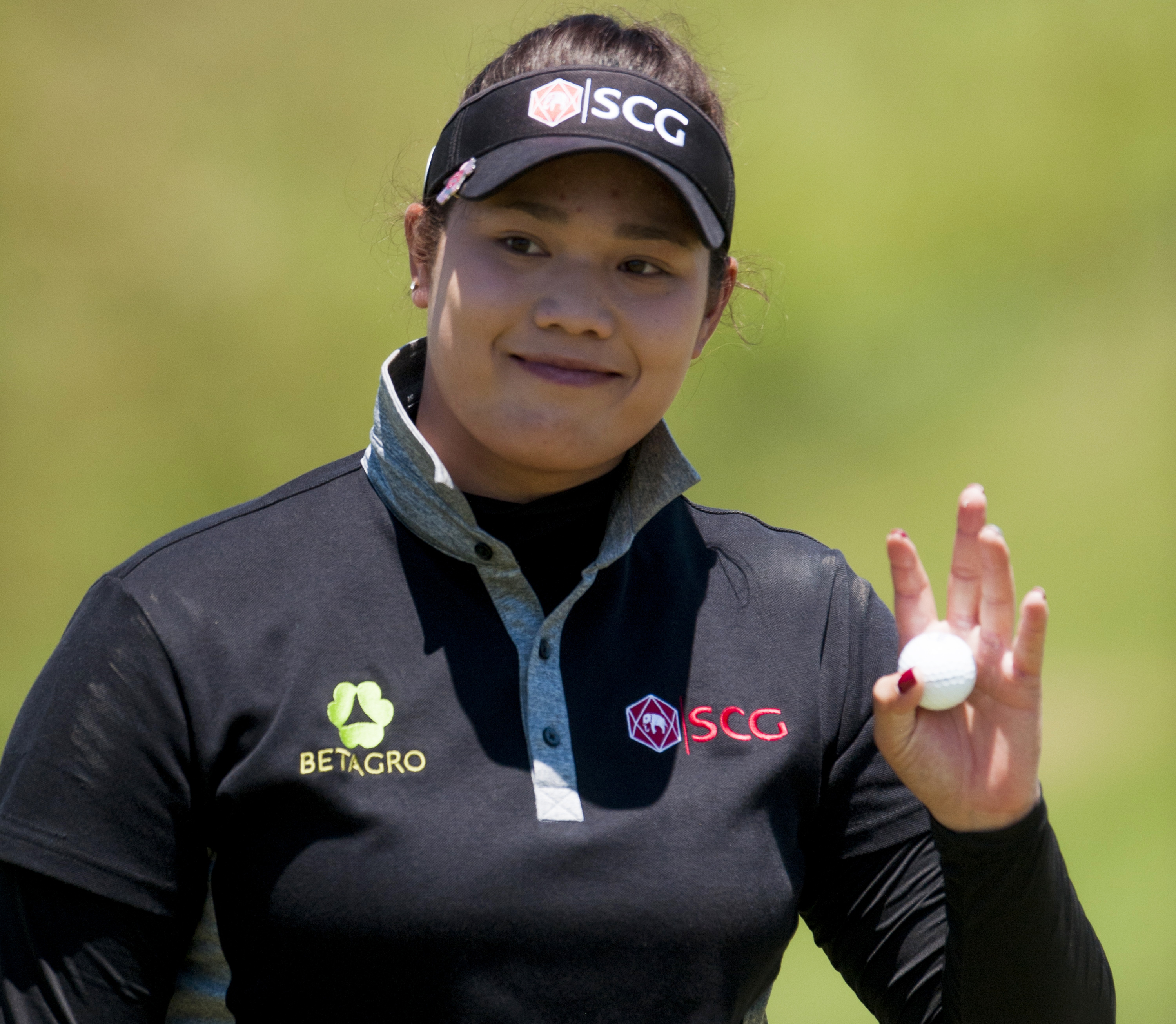 Ariya Jutanugarn waves to spectators after making a birdie on hole four during round four of the Yokohama Tire LPGA Classic golf tournament in Prattville, Ala., Sunday, May 8, 2016. (Mickey Welsh/The Montgomery Advertiser via AP)  NO SALES; MANDATORY CRED