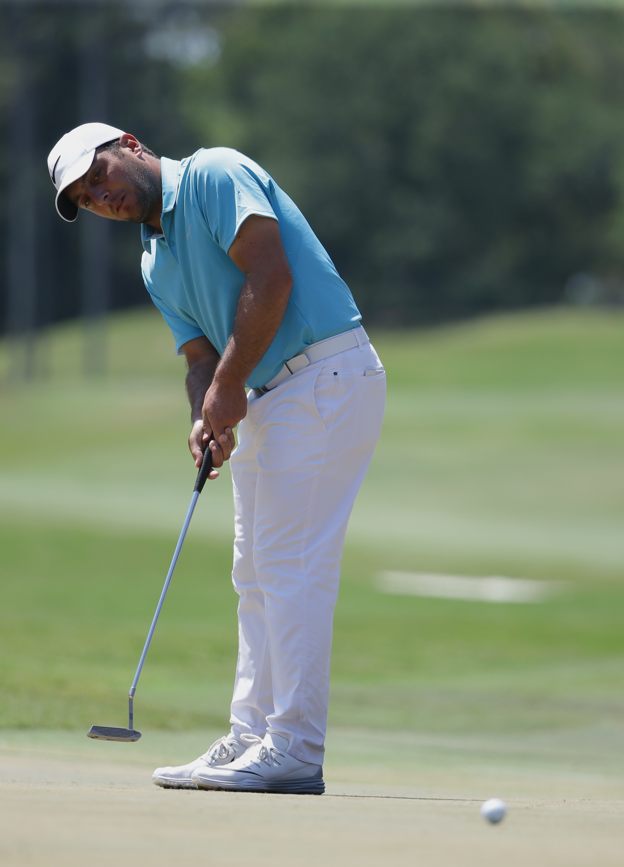 Francesco Molinari of Italy, watches his putt on the fifth green during the third round of The Players Championship golf tournament Saturday, May 14, 2016, in Ponte Vedra Beach, Fla. (AP Photo/Lynne Sladky)