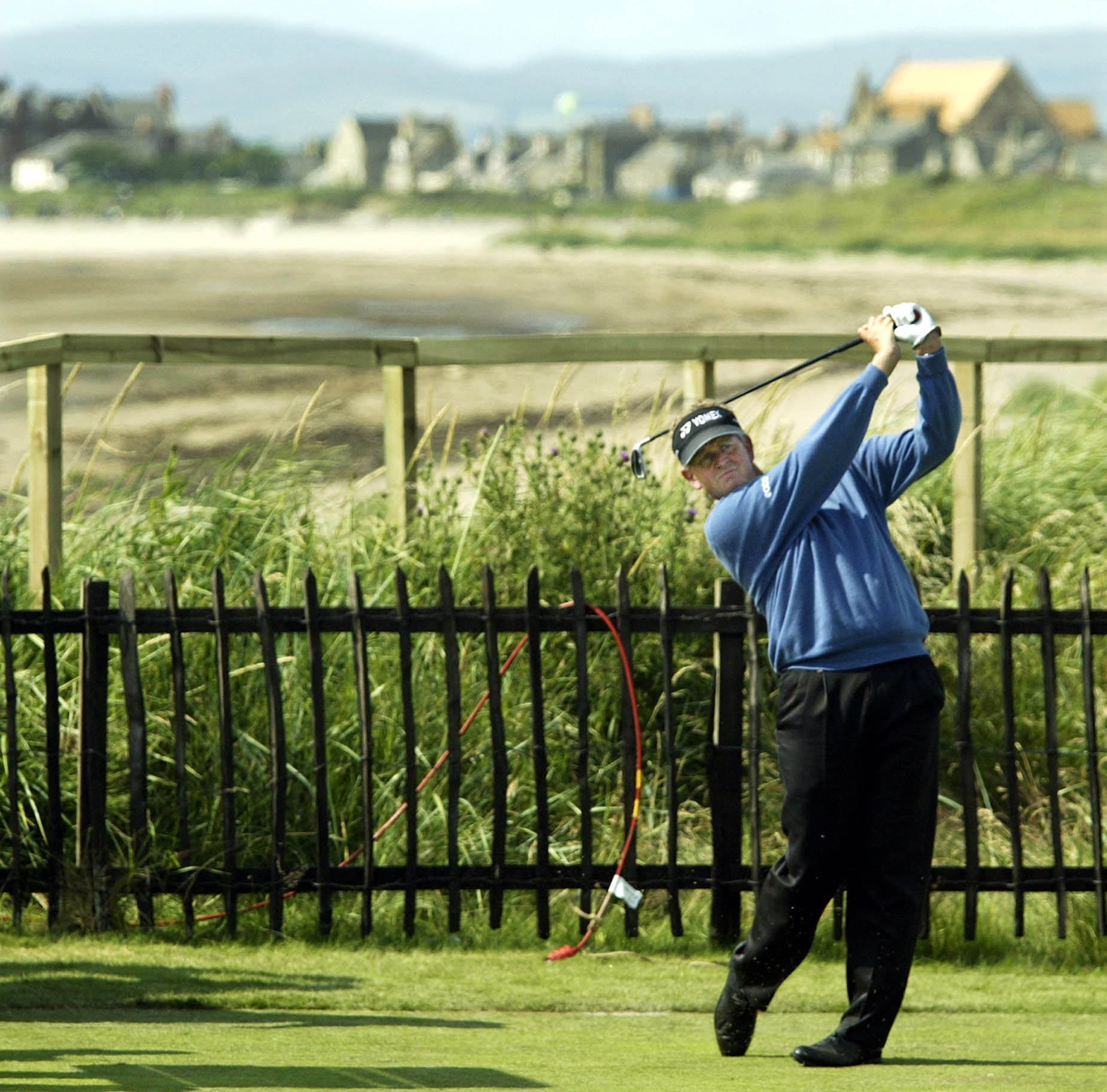 Scotland's Colin Montgomerie tees off on the second tee Monday, July 12, 2004 during a practice round for the upcoming British Open at Royal Troon golf course in Troon, Scotland. The course is Montgomery's home course, and his father once served as club s