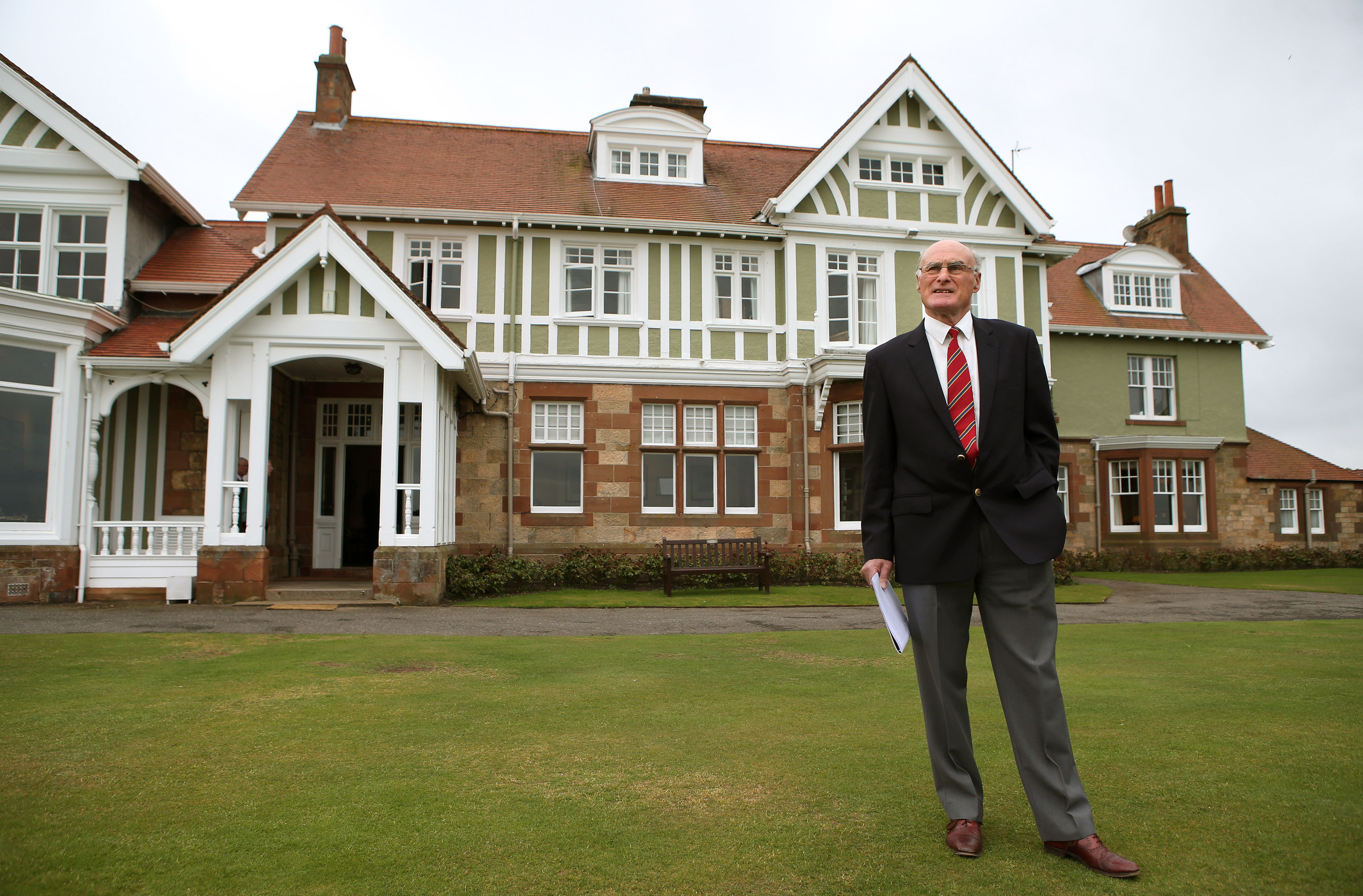 Captain of Muirfield Golf Club, Henry Fairweather stands in front of Muirfield golf club clubhouse, as he prepares to make an announcement on the outcome of a membership ballot, against admitting women as club members, in Muirfield, Scotland, Thursday May