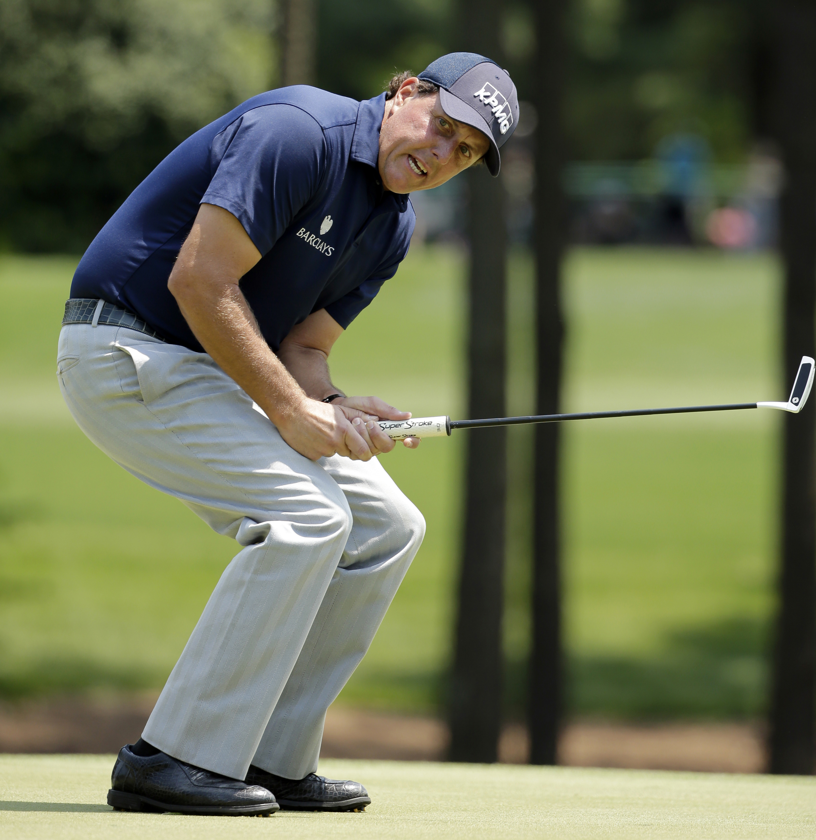 FILE - In this May 7, 2016, file photo, Phil Mickelson reacts as he misses a putt on the third hole during the third round of the Wells Fargo Championship golf tournament at Quail Hollow Club in Charlotte, N.C. The Securities And Exchange Commission is fi