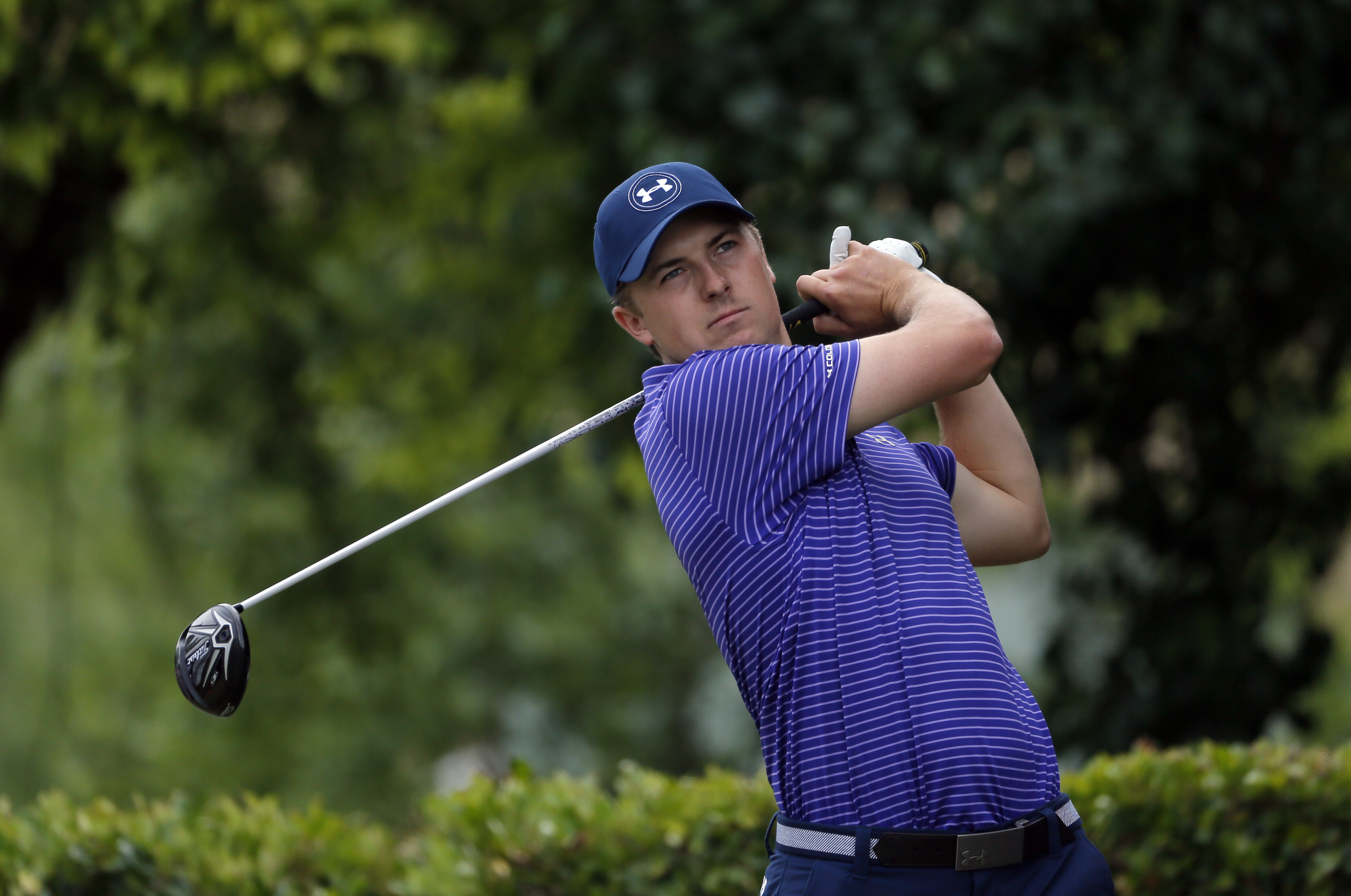 Jordan Spieth hits off of the first tee during the opening round of the Byron Nelson golf tournament, Thursday, May 19, 2016, in Irving, Texas. (AP Photo/Tony Gutierrez)