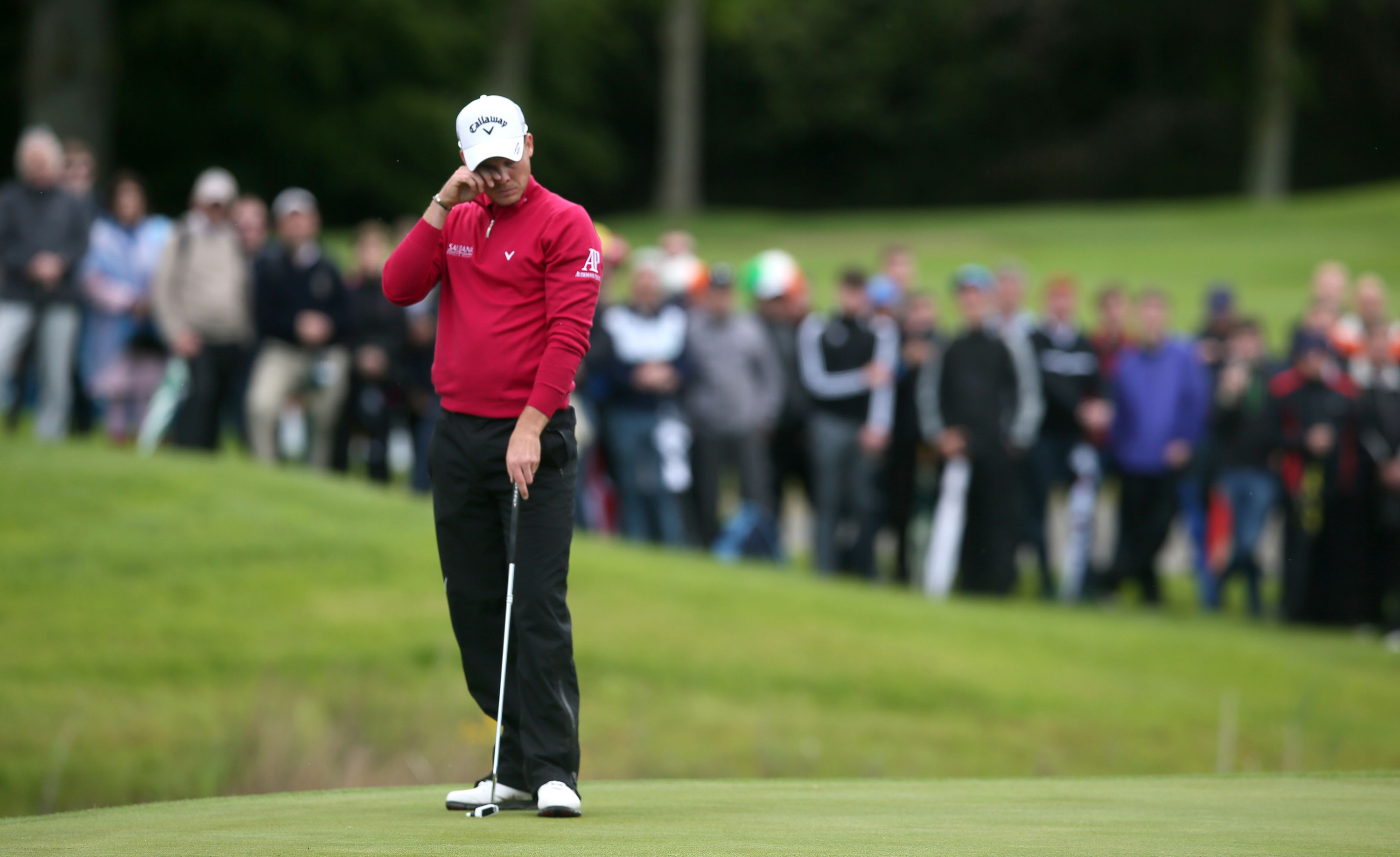 England's Danny Willett reacts after missing a putt on the 12th hole during day four of the Irish Open at The K Club, in Straffan, Ireland, Sunday May 22, 2016. (Brian Lawless / PA via AP) UNITED KINGDOM OUT - NO SALES - NO ARCHIVES