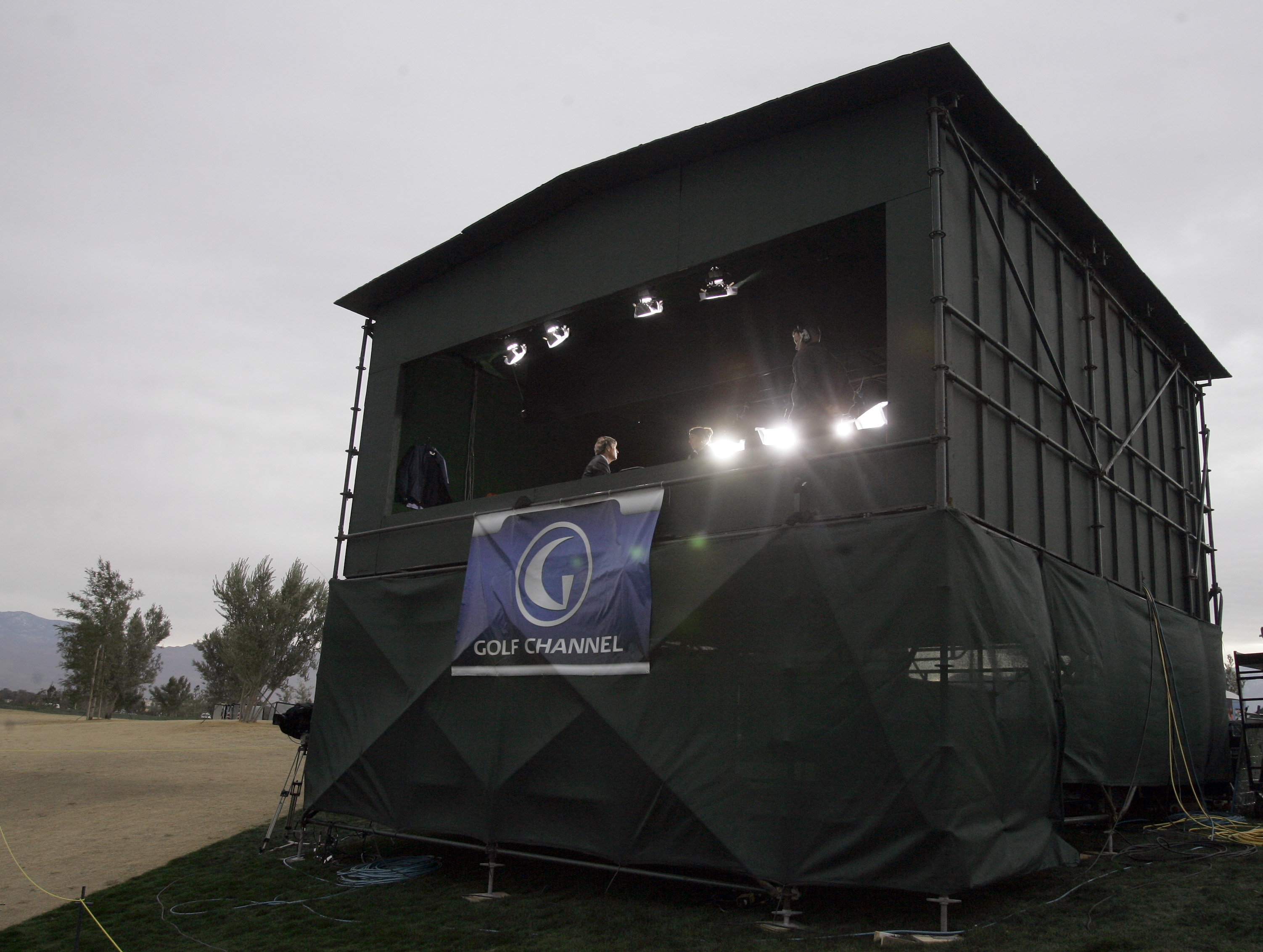 The Golf Channel broadcast booth sits along the 13th fairway at the Classic Club during the third round of the Bob Hope Chrysler Classic in Thousand Palms, Calif., Friday, Jan. 19, 2007. Comcast Corp. is making a big bet on golf, hoping to transform its l