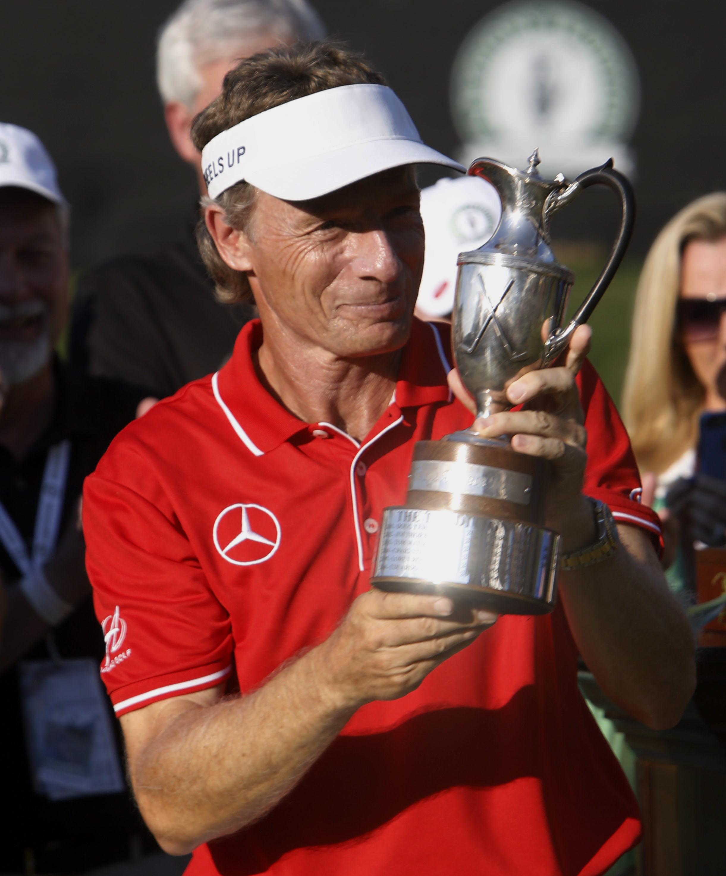 Bernhard Langer, of Germany, poses with the championship trophy after winning the PGA Regions Tradition at the Greystone Golf & Country Club in Birmingham, Ala., Sunday, May 22, 2016. (Hal Yeager/AL.com via AP) MANDATORY CREDIT