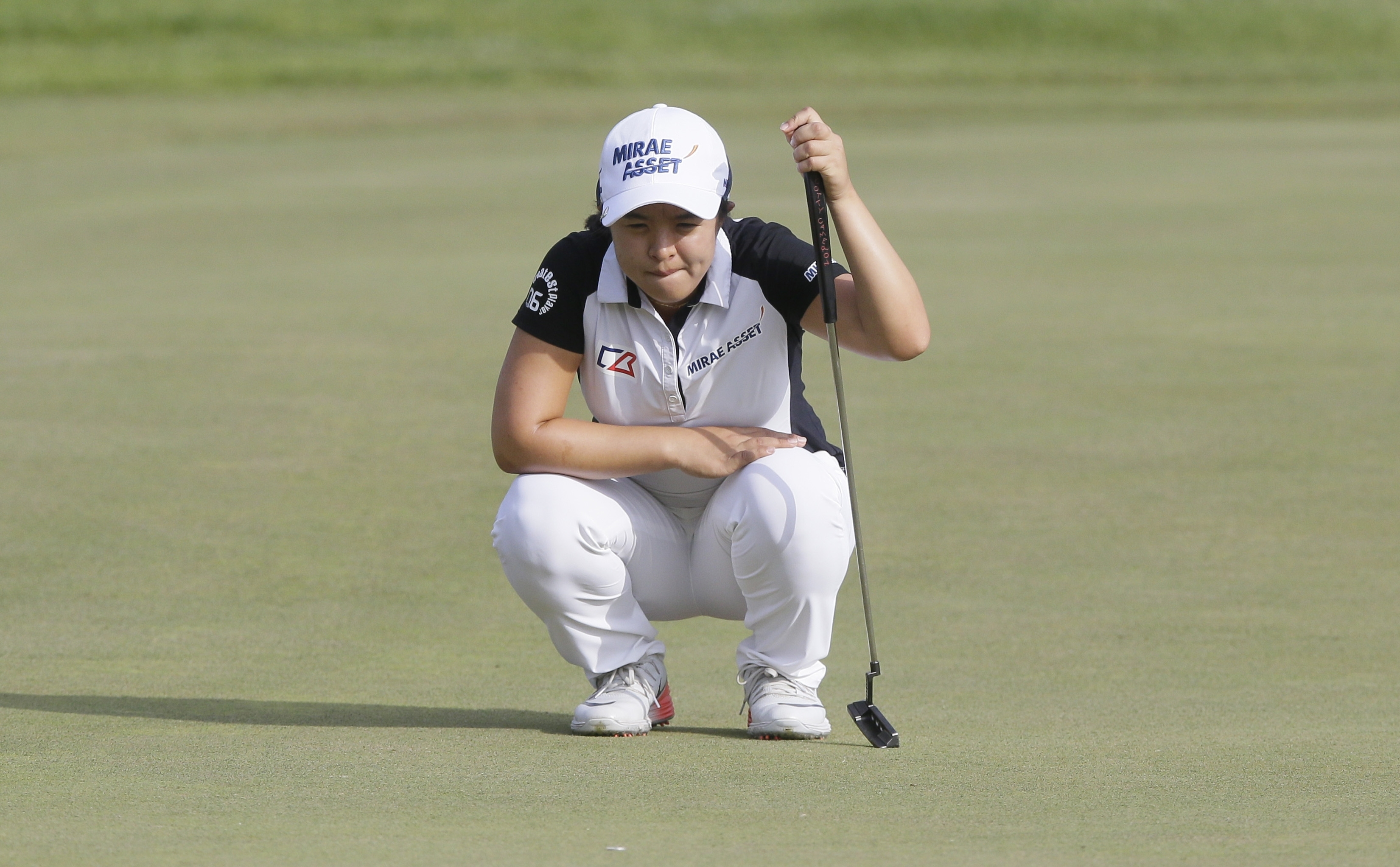 Sei Young Kim, of South Korea, eyes her putt on the 18th green during the first round of the LPGA Volvik Championship golf tournament at Travis Pointe Country Club, Thursday, May 26, 2016, in Ann Arbor, Mich. (AP Photo/Carlos Osorio)