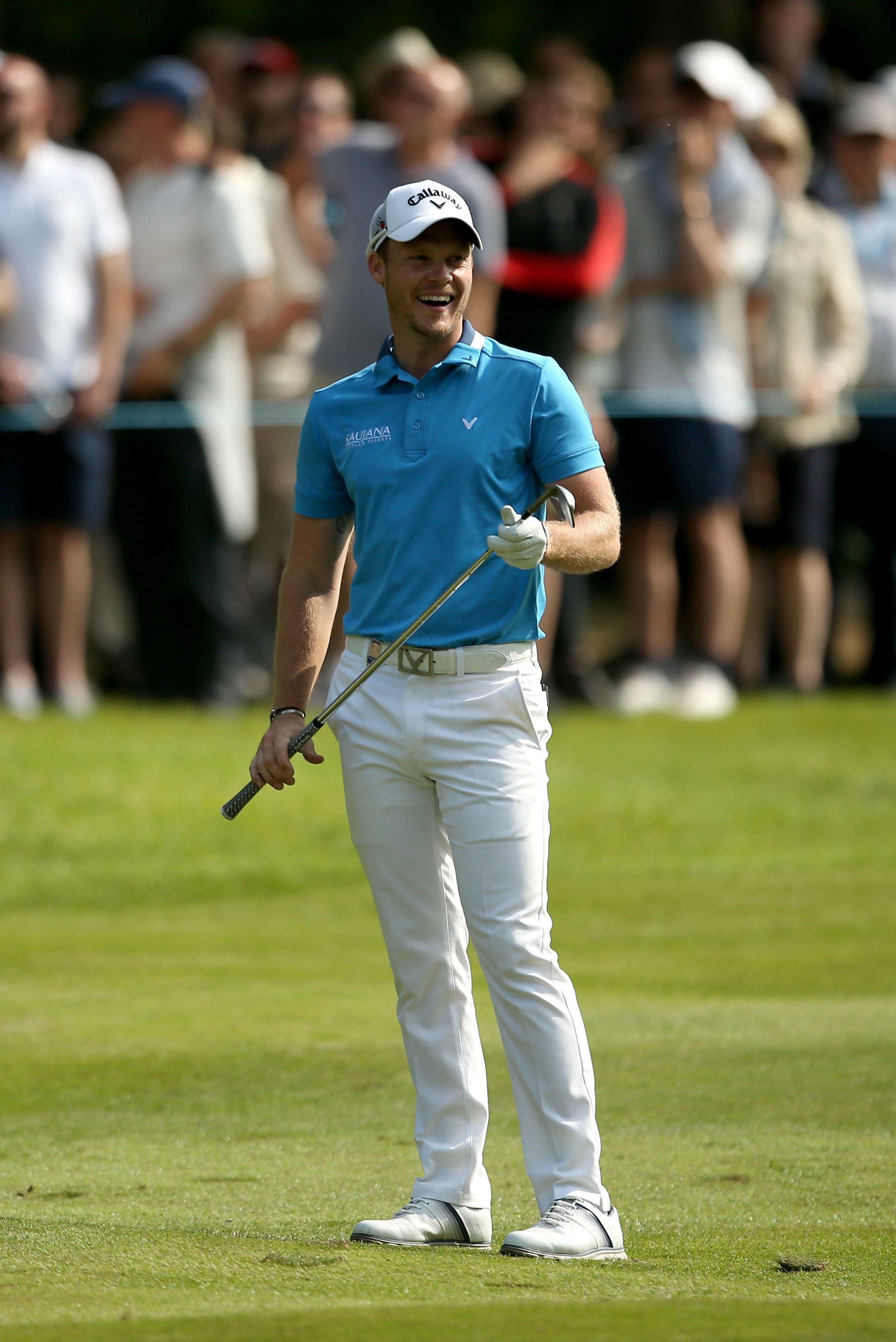 England's Masters champion Danny Willett reacts on the sixteenth hole during day three of the PGA Championship at Wentworth Club, Virginia Water, England, Saturday May 28, 2016. Willett made six birdies in a tournament-record 29 on the front nine on Frida
