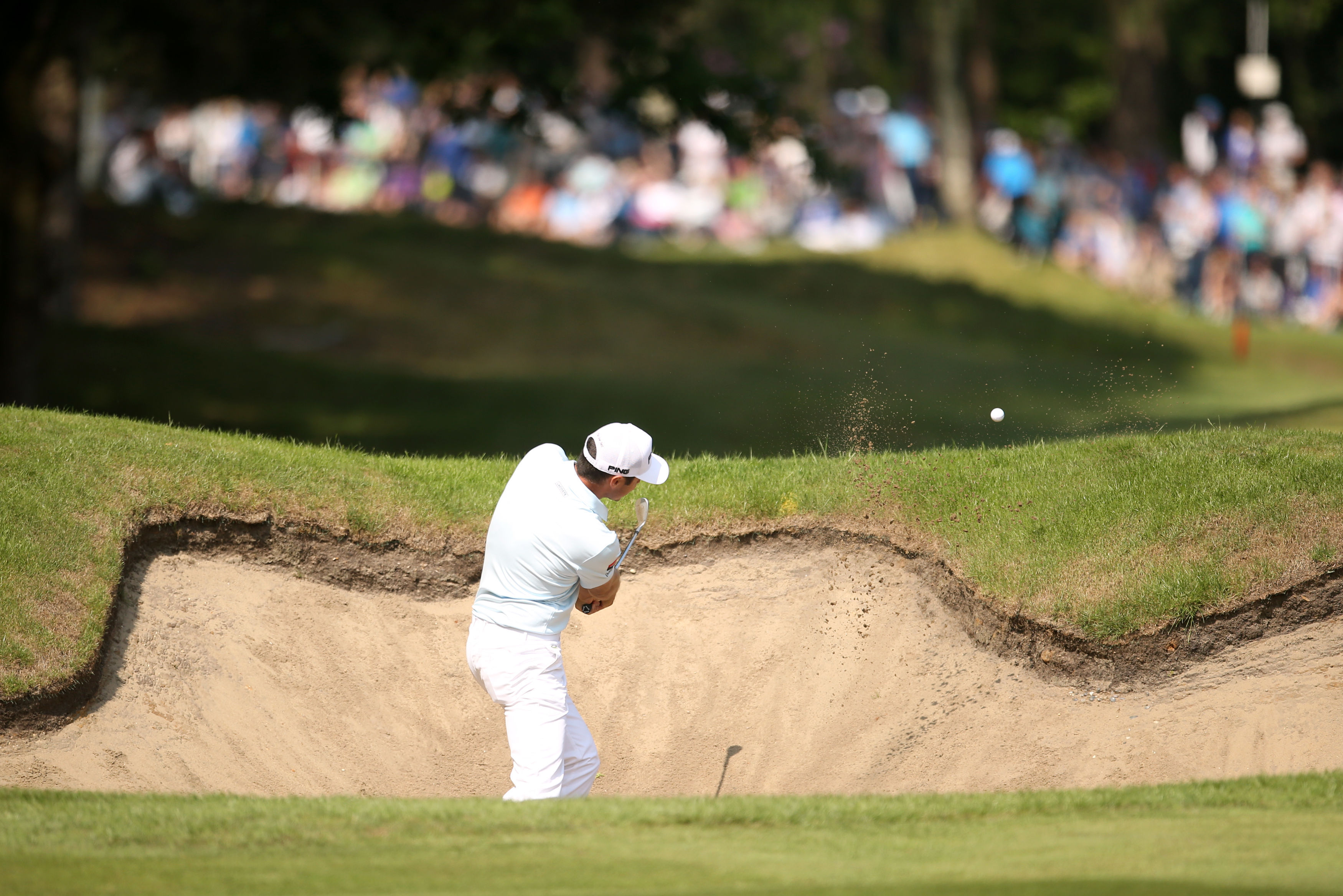 France's Julien Quesne plays a bunker shot on the 13th hole, during day four of the PGA golf Championship at Wentworth Club, Windsor, England, Sunday, May 29, 2016. (Steve Paston/PA via AP)     UNITED KINGDOM OUT        -      NO SALES      -      NO ARCH