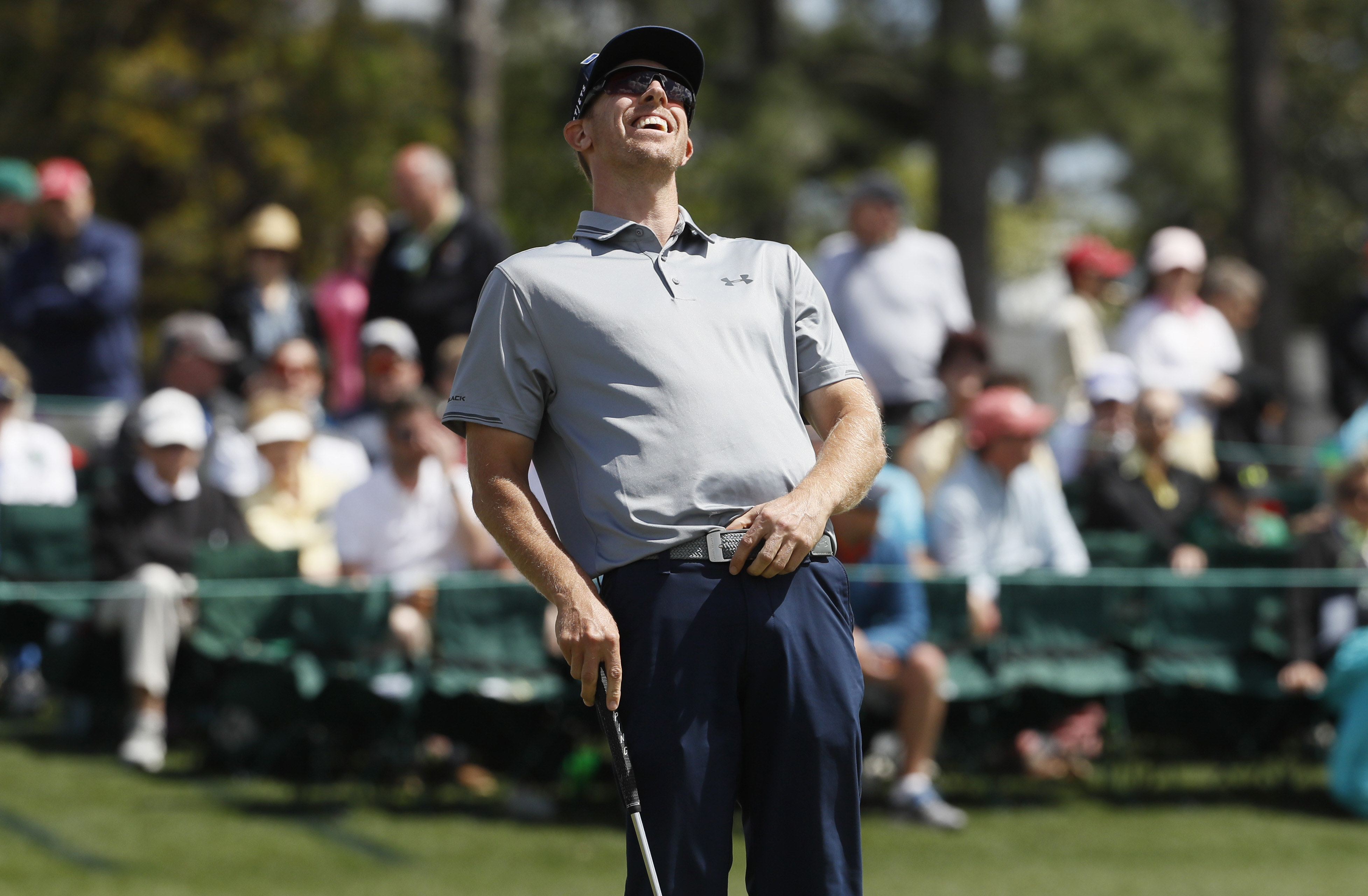 FILE - In this April 8, 2016, file phot,o Hunter Mahan reacts to a missed birdie putt on the 18th hole in the second round of the Masters golf tournament in Augusta, Ga. Once as high as No. 4 in the world, he is at No. 143 and falling. At home, his wife i