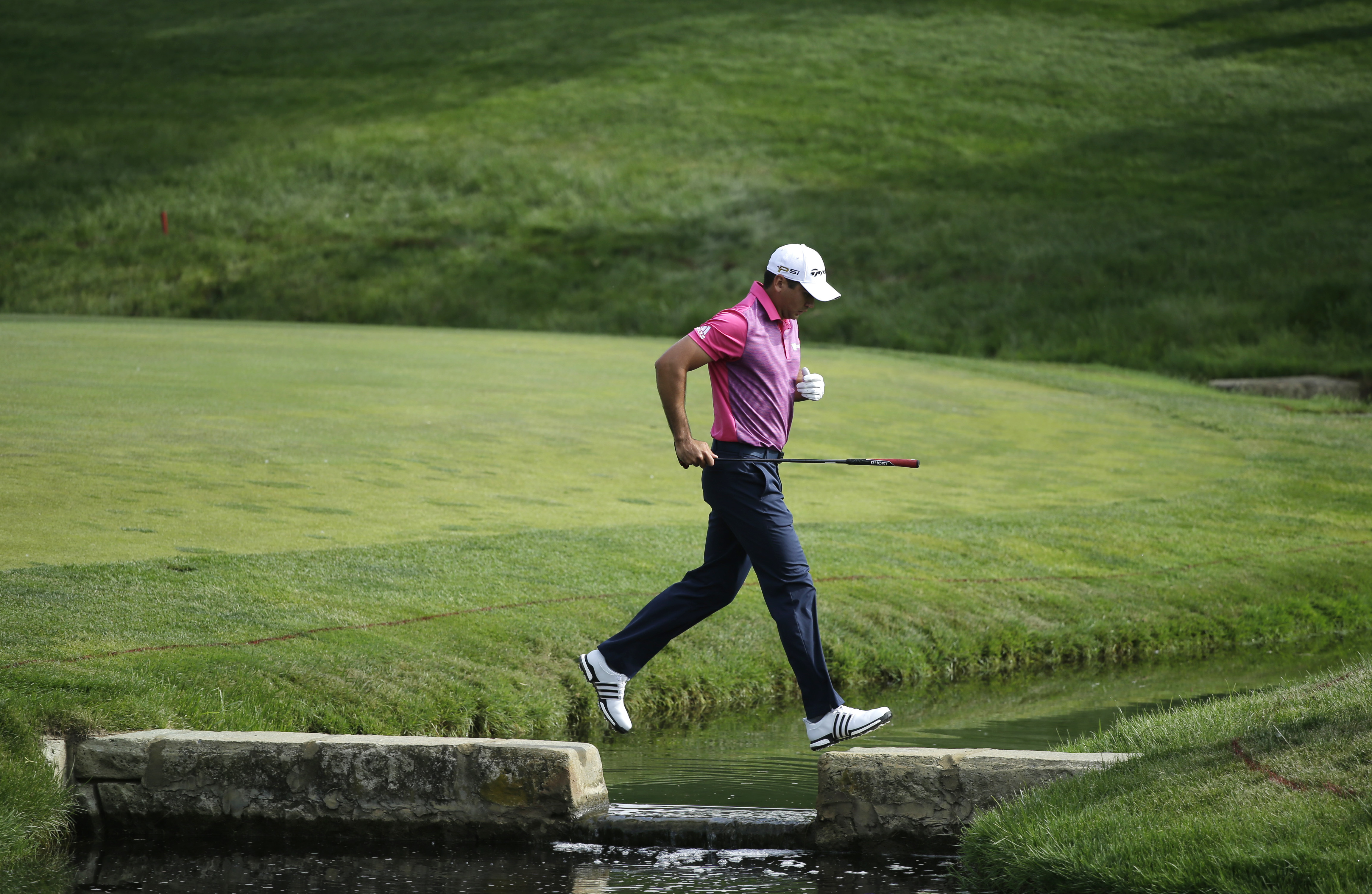 Jason Day, of Australia, walks to the 14th green during the second round of the Memorial golf tournament, Friday, June 3, 2016, in Dublin, Ohio. (AP Photo/Darron Cummings)