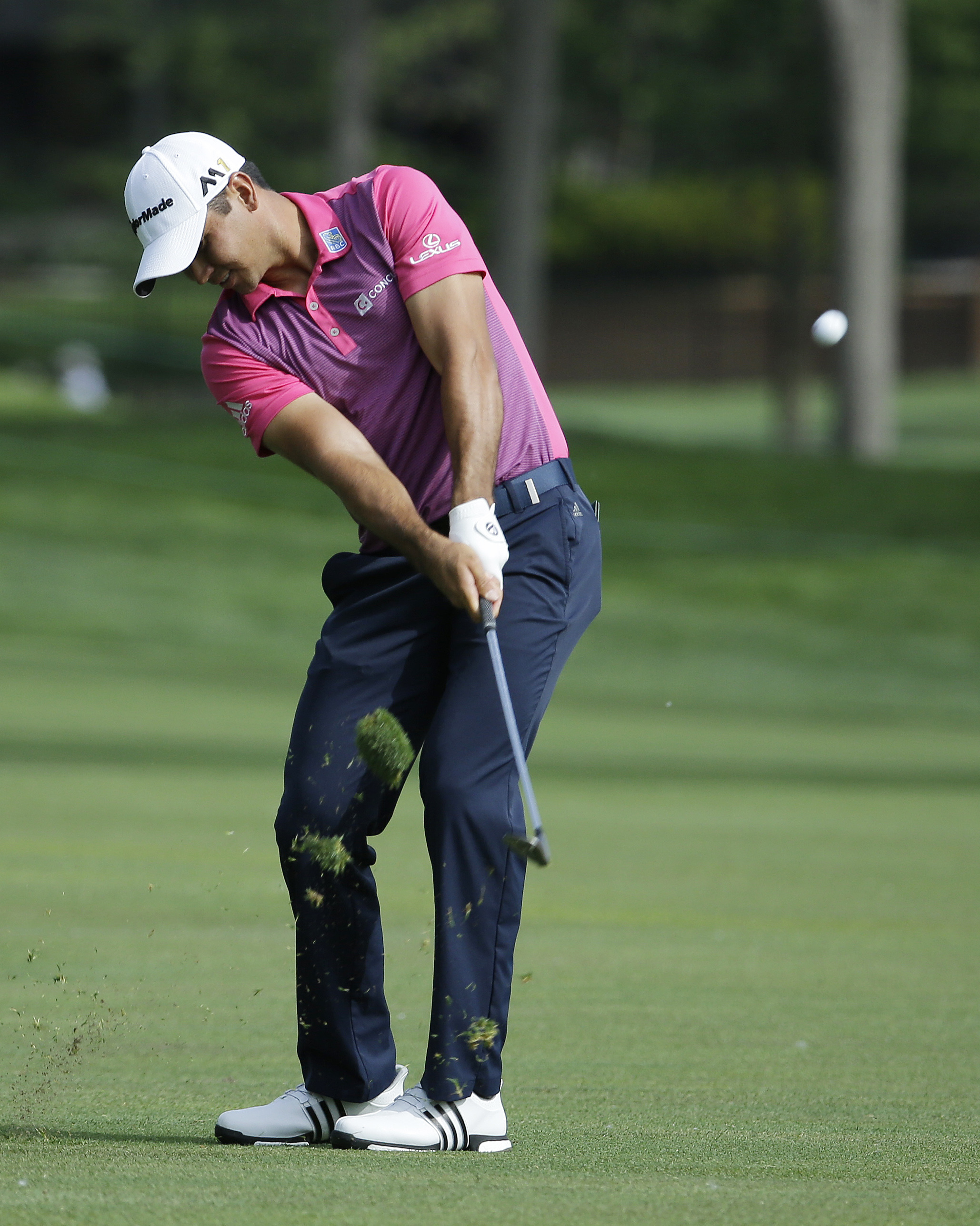 Jason Day, of Australia, hits on the 14th hole during the second round of the Memorial golf tournament, Friday, June 3, 2016, in Dublin, Ohio. (AP Photo/Darron Cummings)