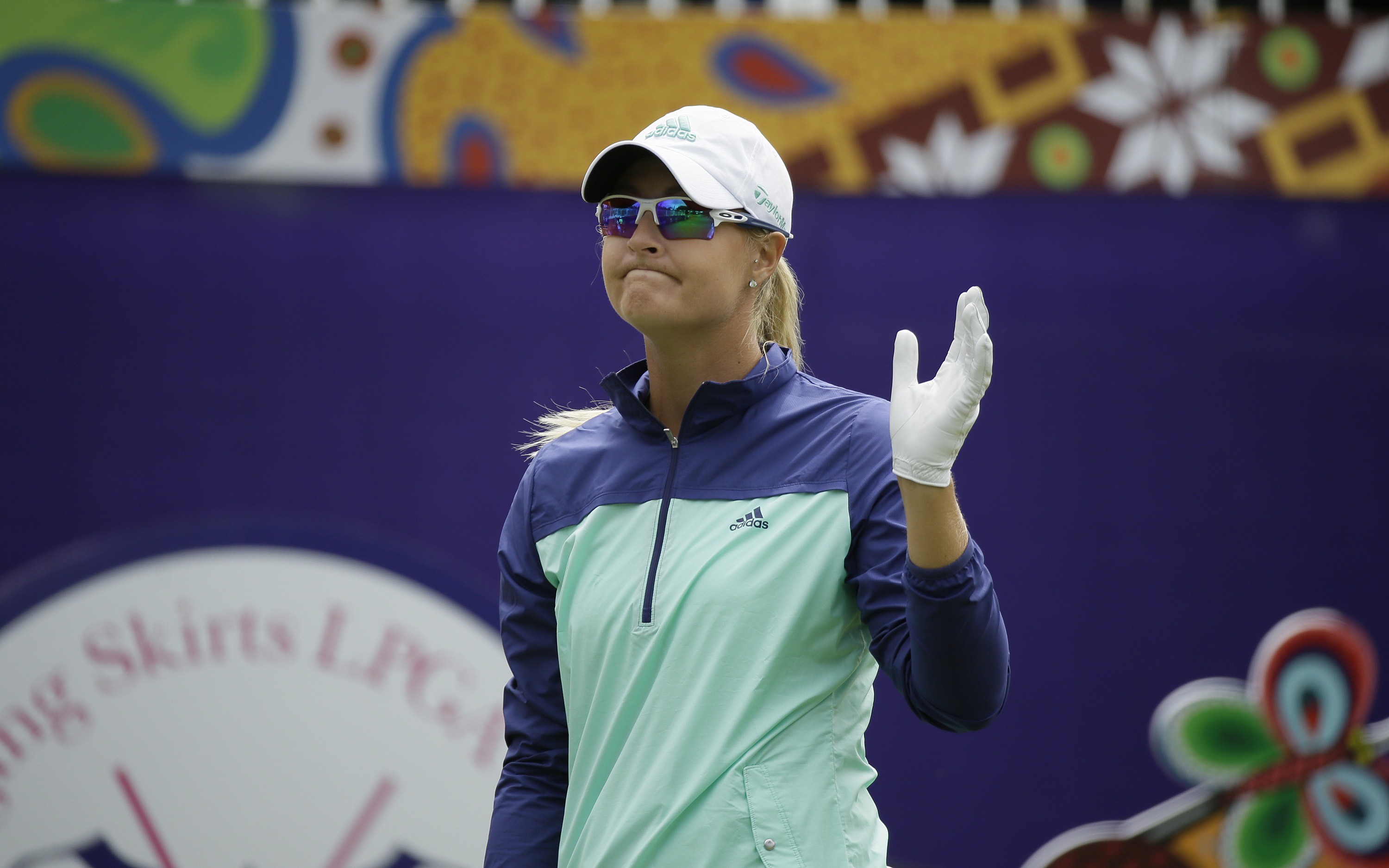 Anna Nordqvist, of Sweden, waves before hitting from the first tee of the Lake Merced Golf Club during the first round of the Swinging Skirts LPGA Classic golf tournament Thursday, April 21, 2016, in Daly City, Calif. (AP Photo/Eric Risberg)