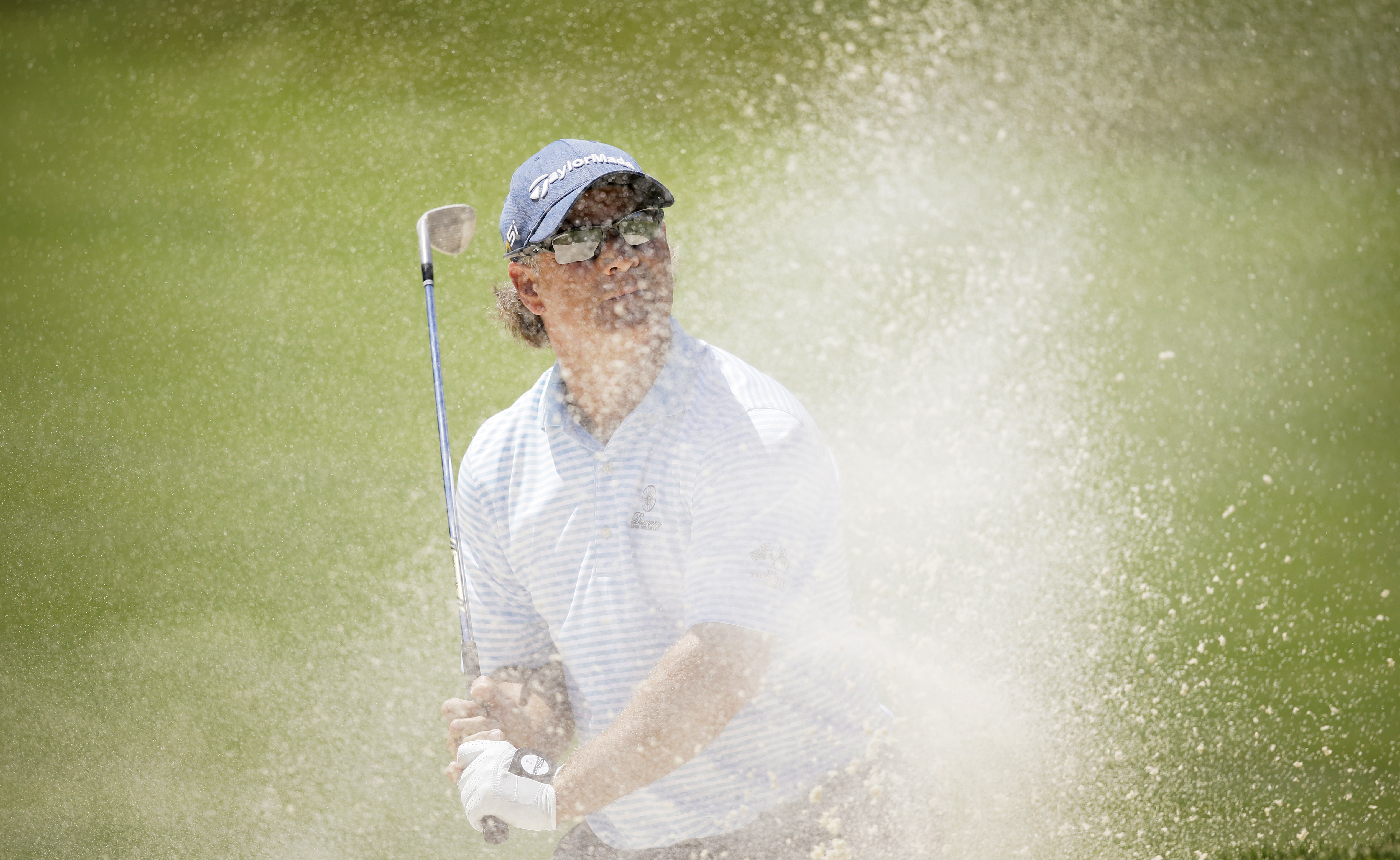 Scott McCarron hits out of a bunker onto the ninth green during the final round of the PGA Tour Champions Principal Charity Classic golf tournament, Sunday, June 5, 2016, in Des Moines, Iowa. (AP Photo/Charlie Neibergall)