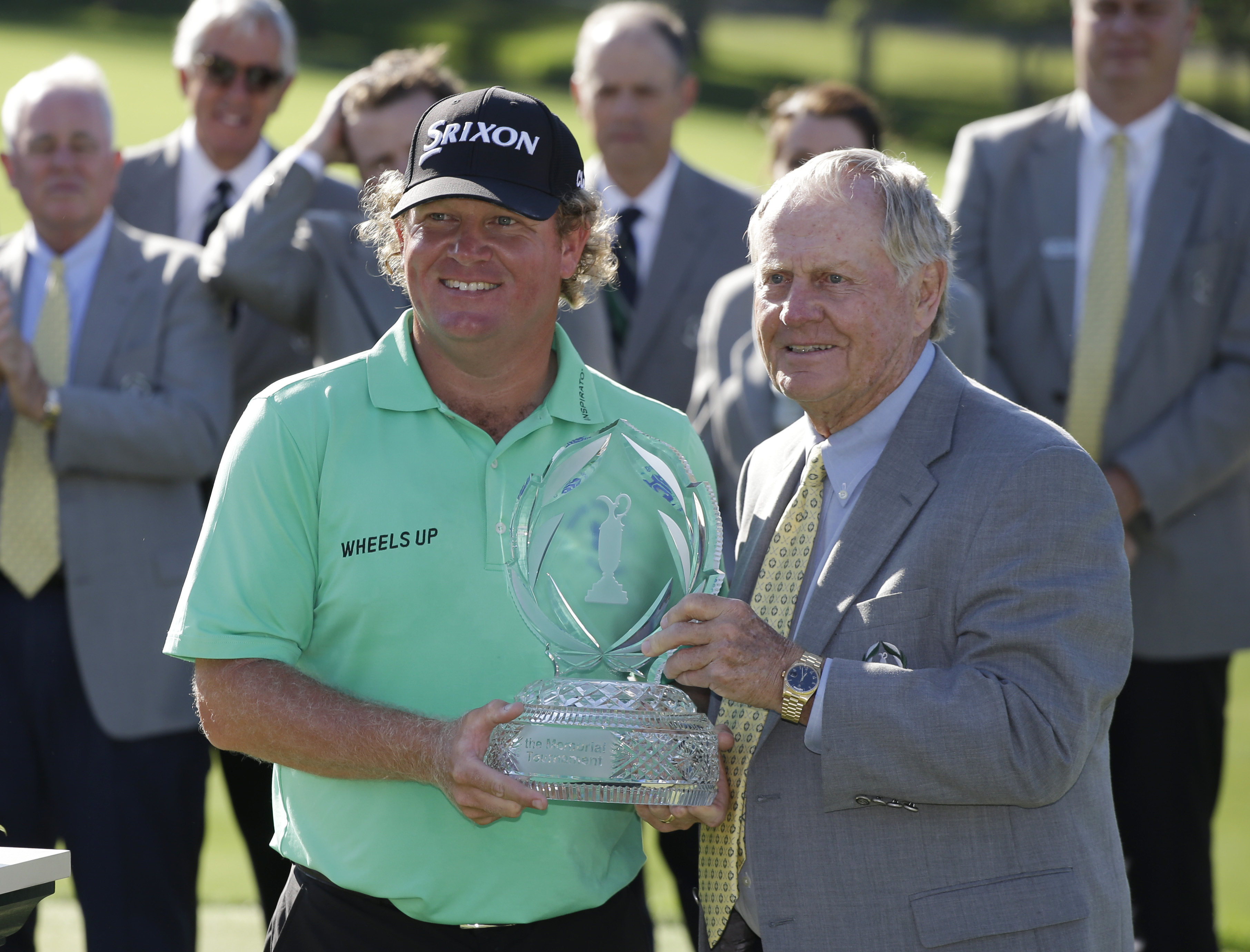 Jack Nicklaus presents the trophy to William McGirt after McGirt won the Memorial golf tournament in a playoff, Sunday, June 5, 2016, in Dublin, Ohio. (AP Photo/Darron Cummings)