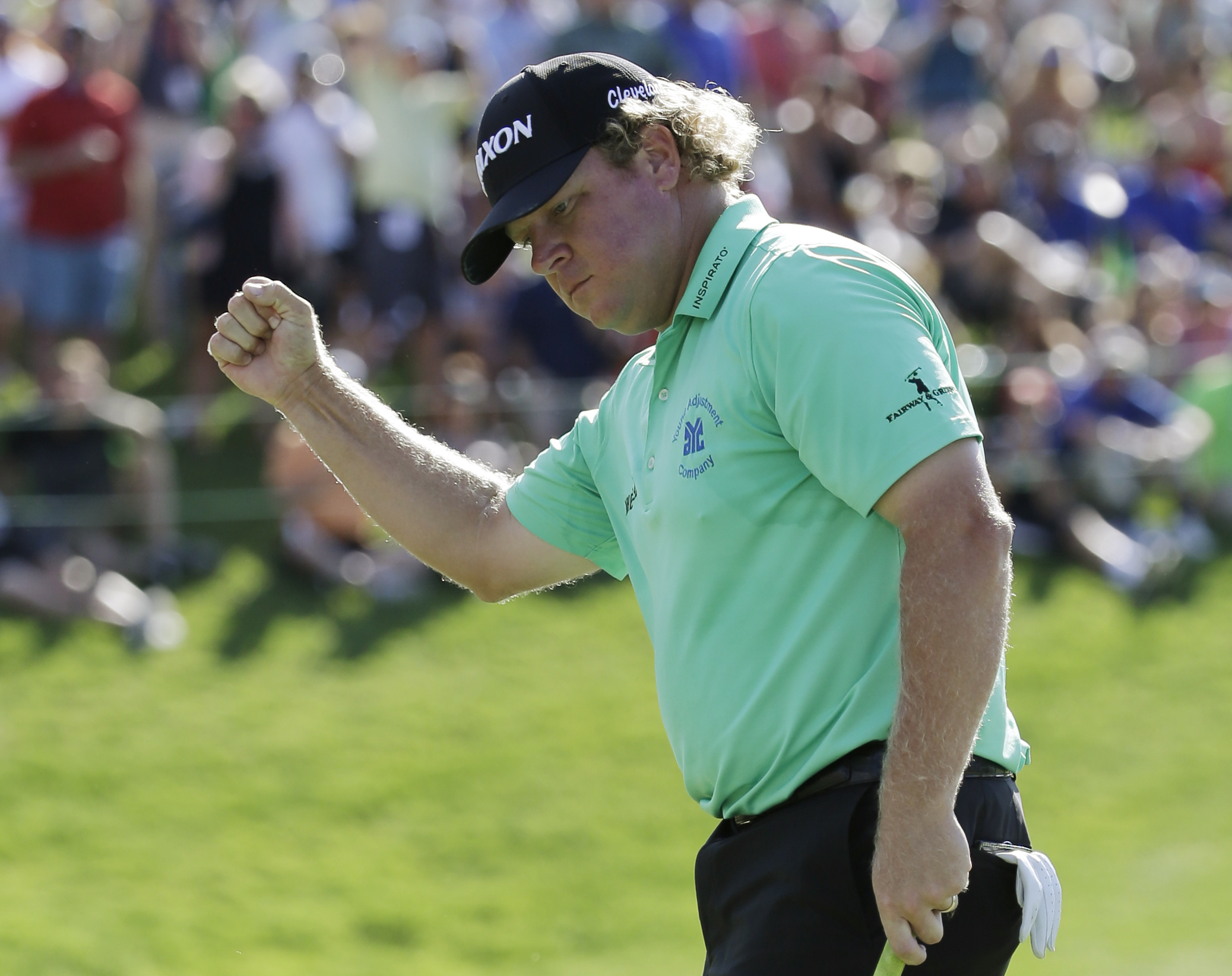 William McGirt celebrates after winning the Memorial golf tournament in a playoff, Sunday, June 5, 2016, in Dublin, Ohio. (AP Photo/Darron Cummings)