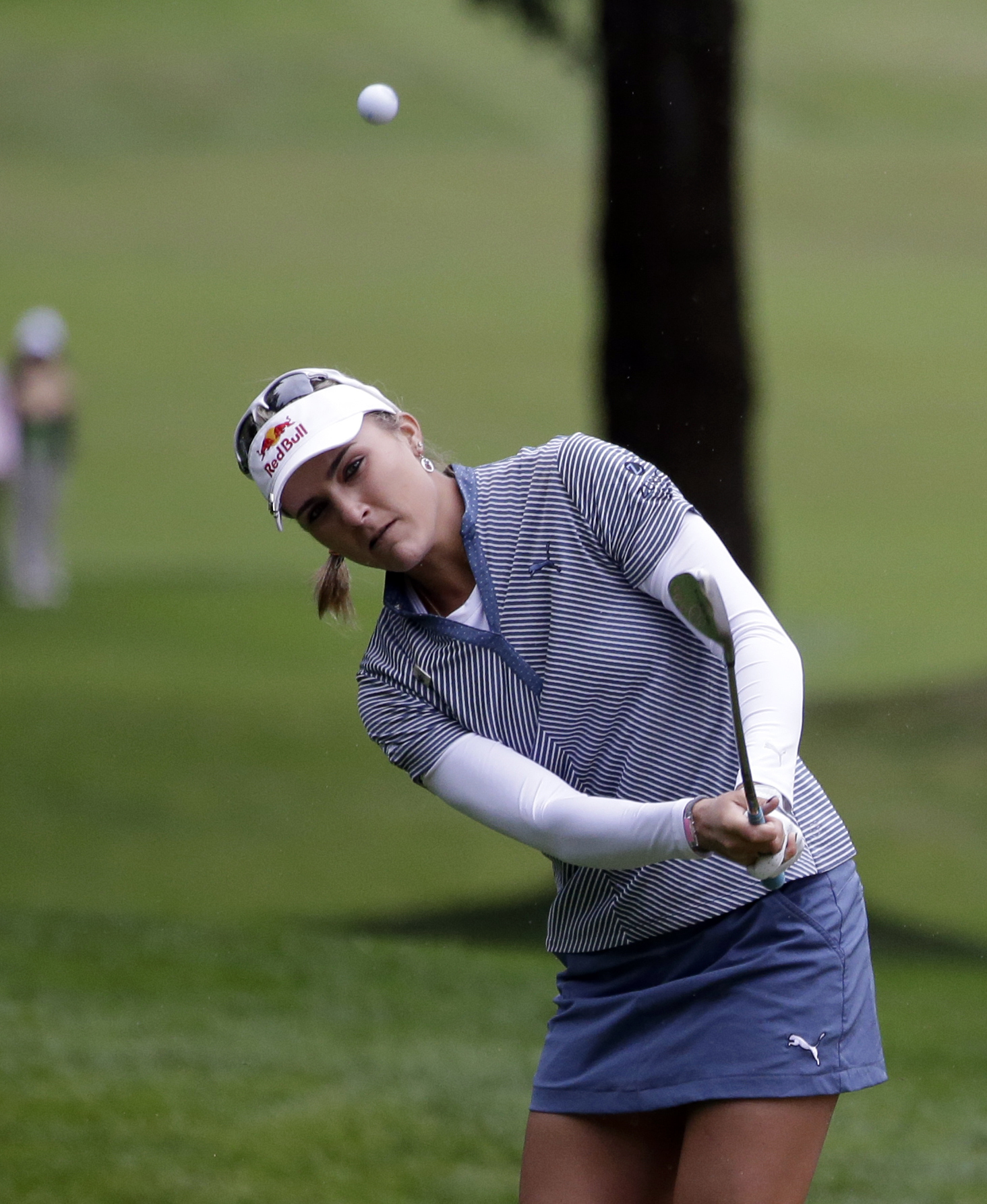 Lexi Thompson hits a shot on the sixth hole during the second round at the Women's PGA Championship golf tournament at Sahalee Country Club on Friday, June 10, 2016, in Sammamish, Wash. (AP Photo/Elaine Thompson)