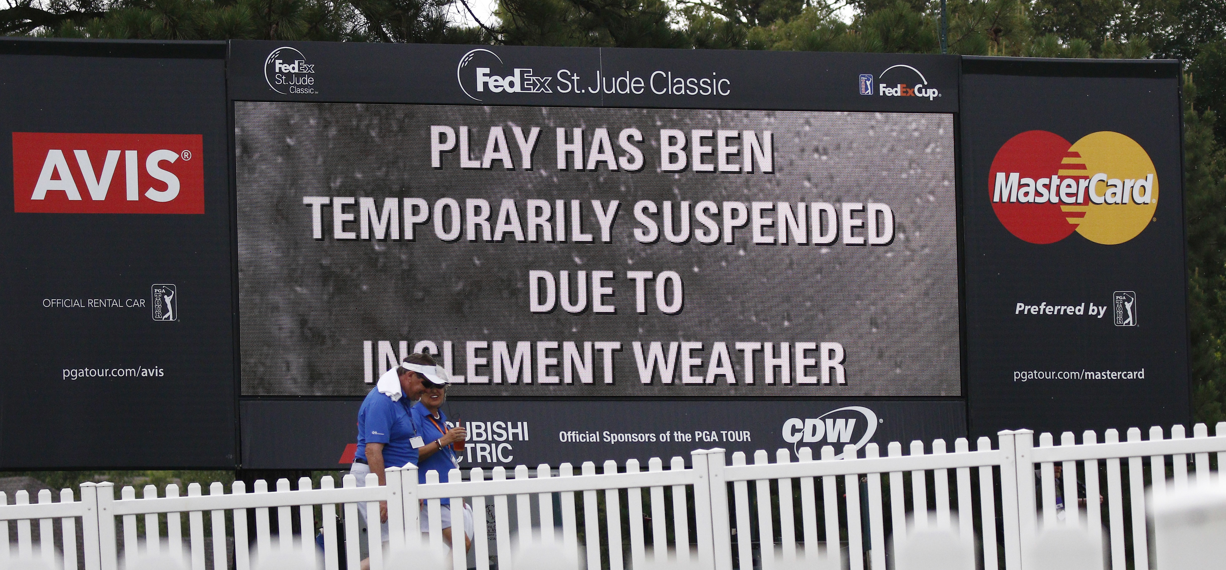 Warning signage informs players and fans of the play being temporarily suspended due to inclement weather on the final round of the FedEx St. Jude Classic Golf Tournament, Sunday, June 12, 2016, in Memphis, Tenn. (AP Photo/Rogelio V. Solis)