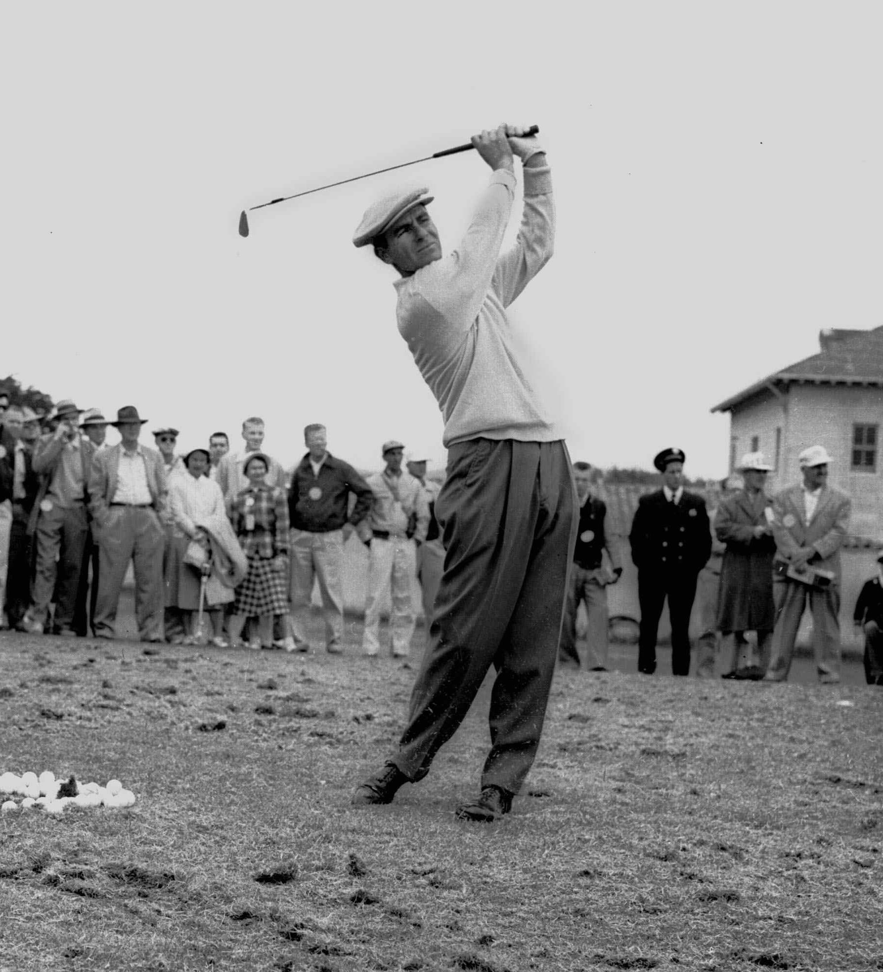 FILE - In this June 17, 1955, file photo, Jack Fleck warms up before a playoff with Ben Hogan for the U.S. Open golf tournament title in San Francisco. That year's tournament is best known for how unheralded Fleck took down Ben Hogan in one of golf's grea