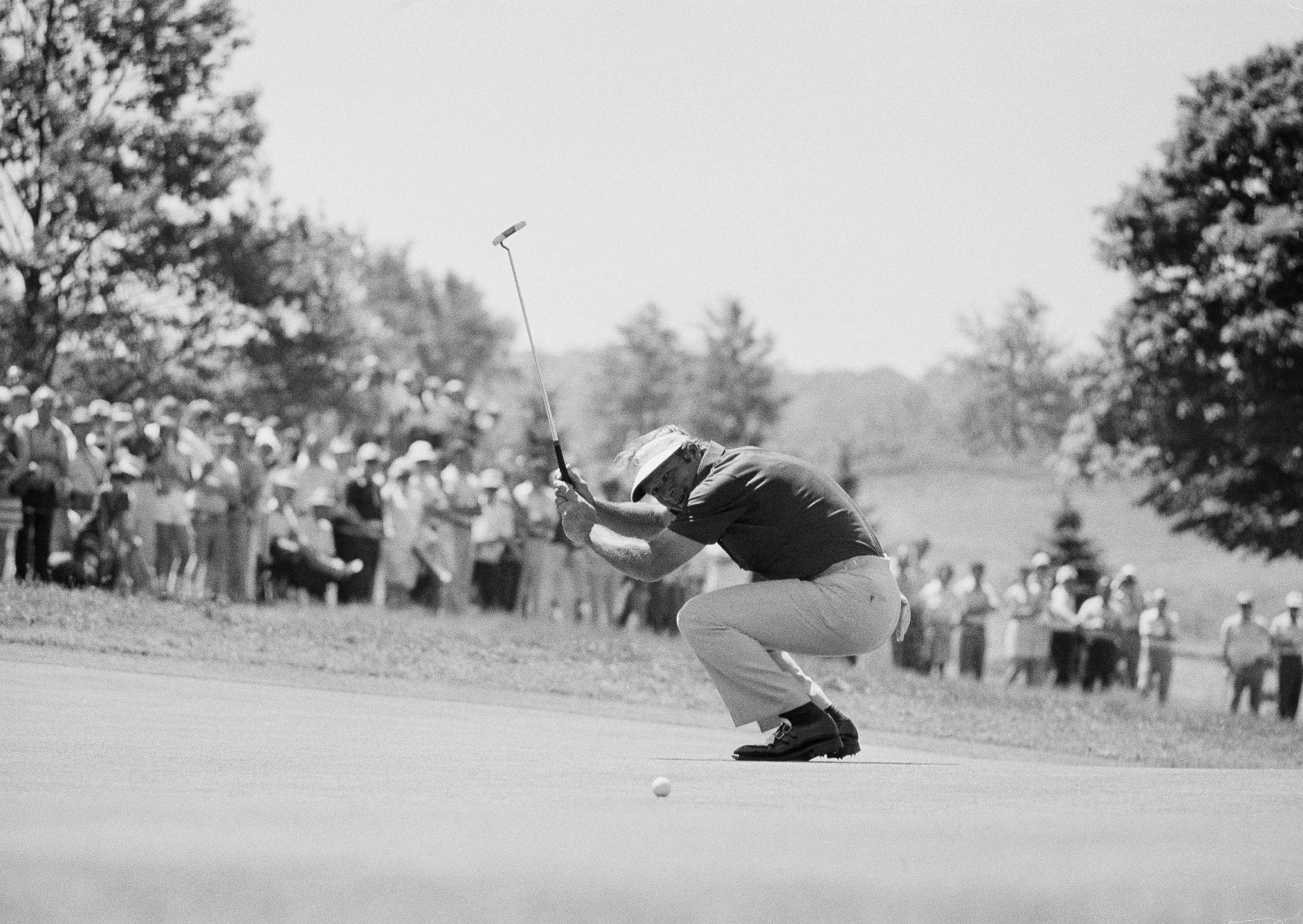 FILE - In this June 15, 1973, file photo, Arnold Palmer waves his putter and smiles after putting, and missing, a birdie on sixth green in second round of the U.S. Open Golf Championship in Oakmont, Pa. A 3-foot-long ramp invented in the 1930s could have