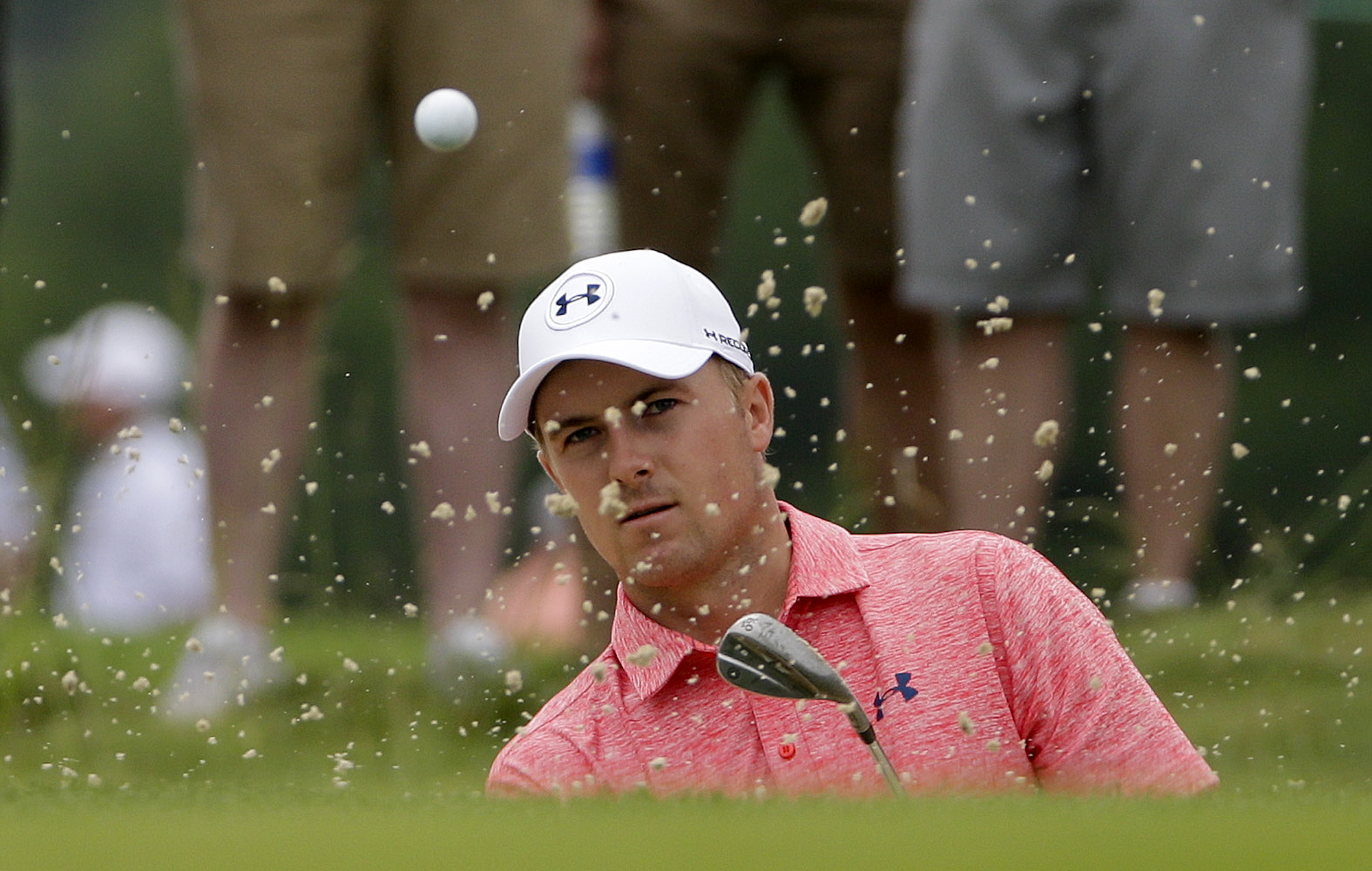 Jordan Spieth hits out of the bunker on the seventh hole during the rain delayed first round of the U.S. Open golf championship at Oakmont Country Club on Friday, June 17, 2016, in Oakmont, Pa. (AP Photo/Gene J. Puskar)