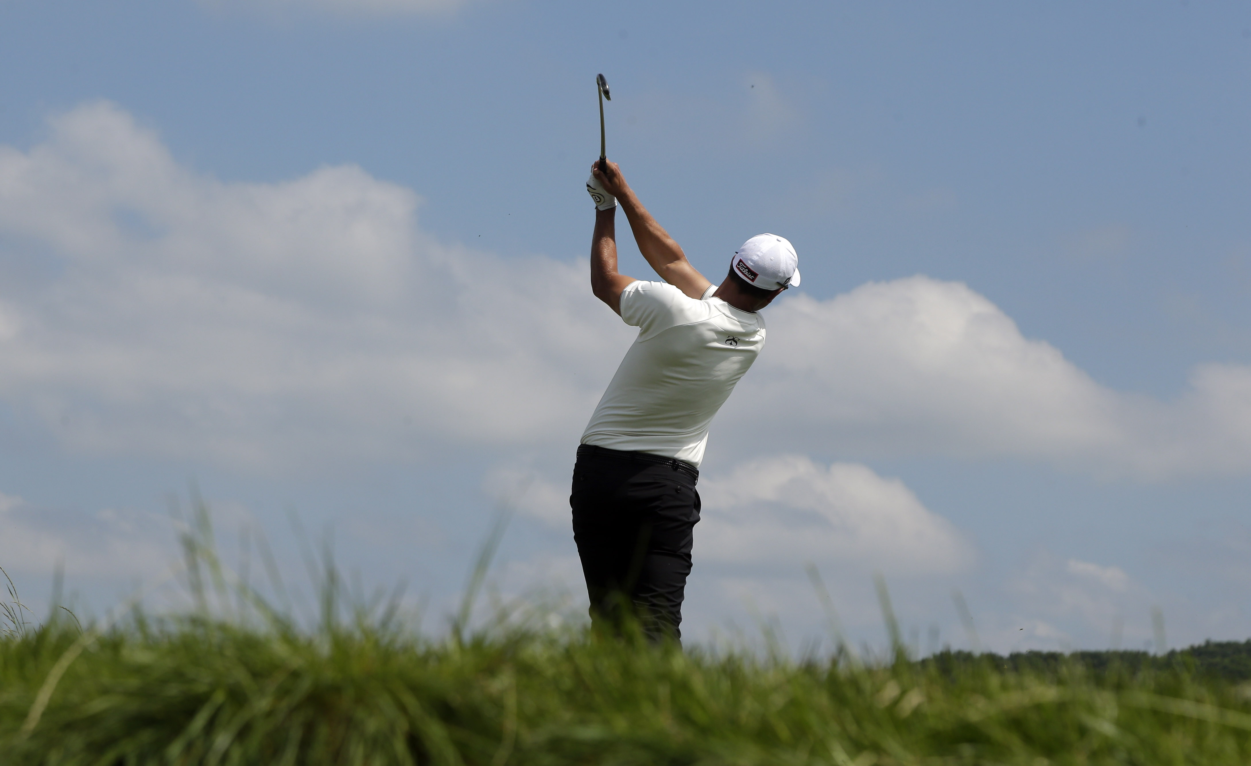 Adam Scott, of Australia, hits his tee shot on the fiith hole during the rain delayed first round of the U.S. Open golf championship at Oakmont Country Club on Friday, June 17, 2016, in Oakmont, Pa. (AP Photo/Charlie Riedel)