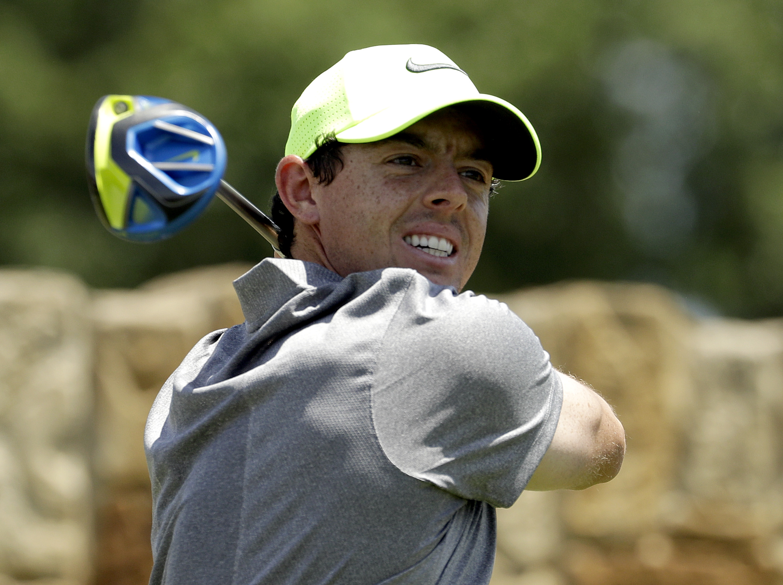 Rory McIlroy, of Northern Ireland, watches his tee shot on the ninth hole during the rain delayed second round of the U.S. Open golf championship at Oakmont Country Club on Saturday, June 18, 2016, in Oakmont, Pa. (AP Photo/Charlie Riedel)