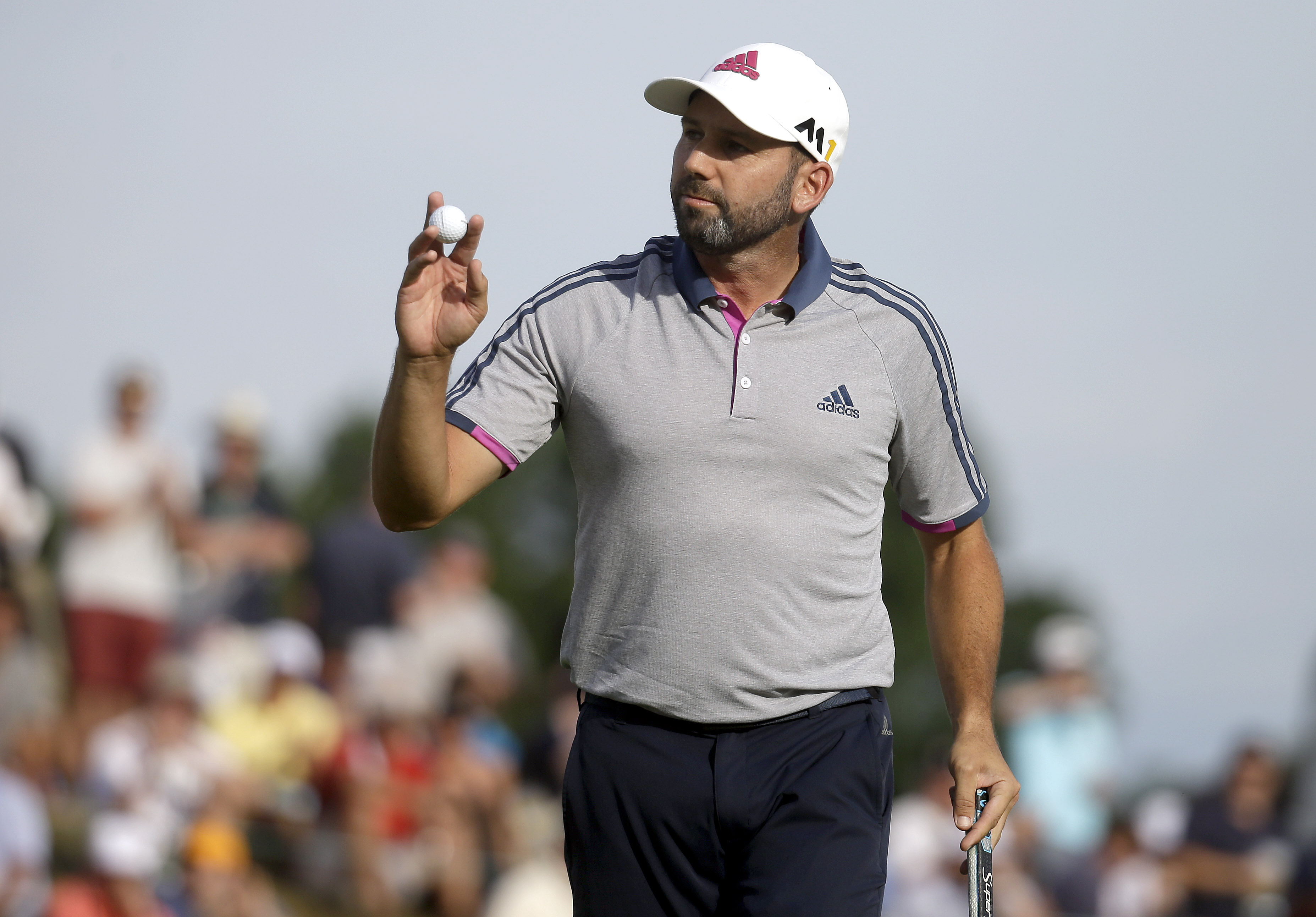 Sergio Garcia, of Spain, reacts to his putt on the sixth hole during third round of the U.S. Open golf championship at Oakmont Country Club on Saturday, June 18, 2016, in Oakmont, Pa. (AP Photo/John Minchillo)