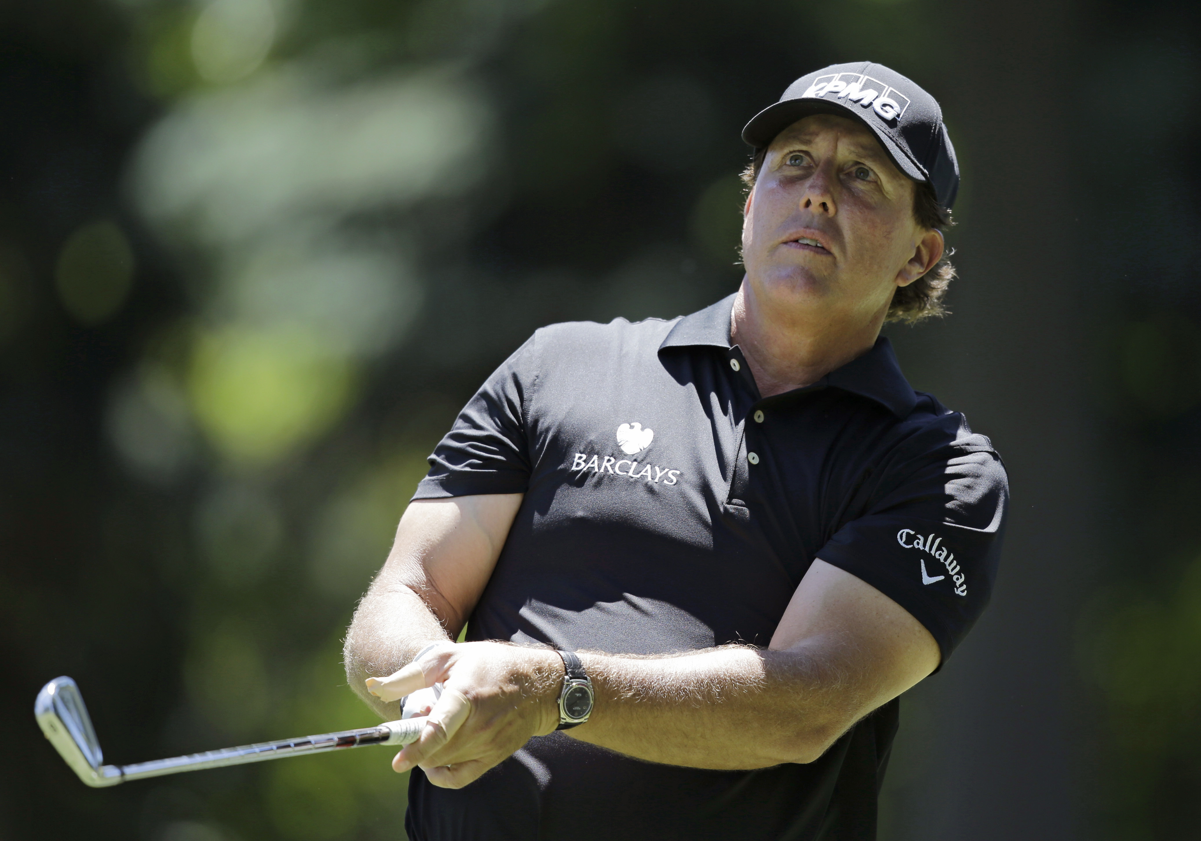 Phil Mickelson hits on the seventh hole during the first round of the Bridgestone Invitational golf tournament at Firestone Country Club, Thursday, June 30, 2016, in Akron, Ohio. (AP Photo/Tony Dejak)