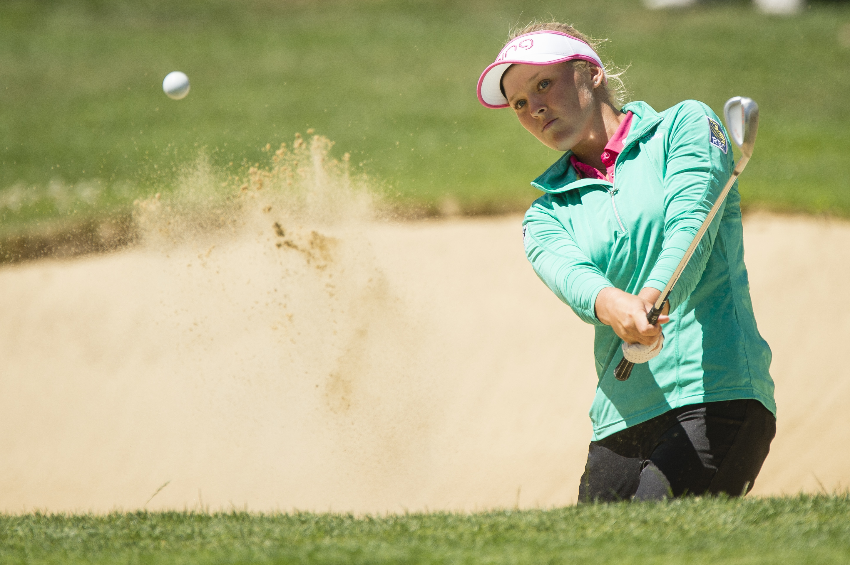 Brooke Henderson, of Canada, hits from a sand trap on the 12th hole at the LPGA Cambia Portland Classic golf tournament Sunday, July 3, 2016, in Portland, Ore. (AP Photo/Troy Wayrynen)