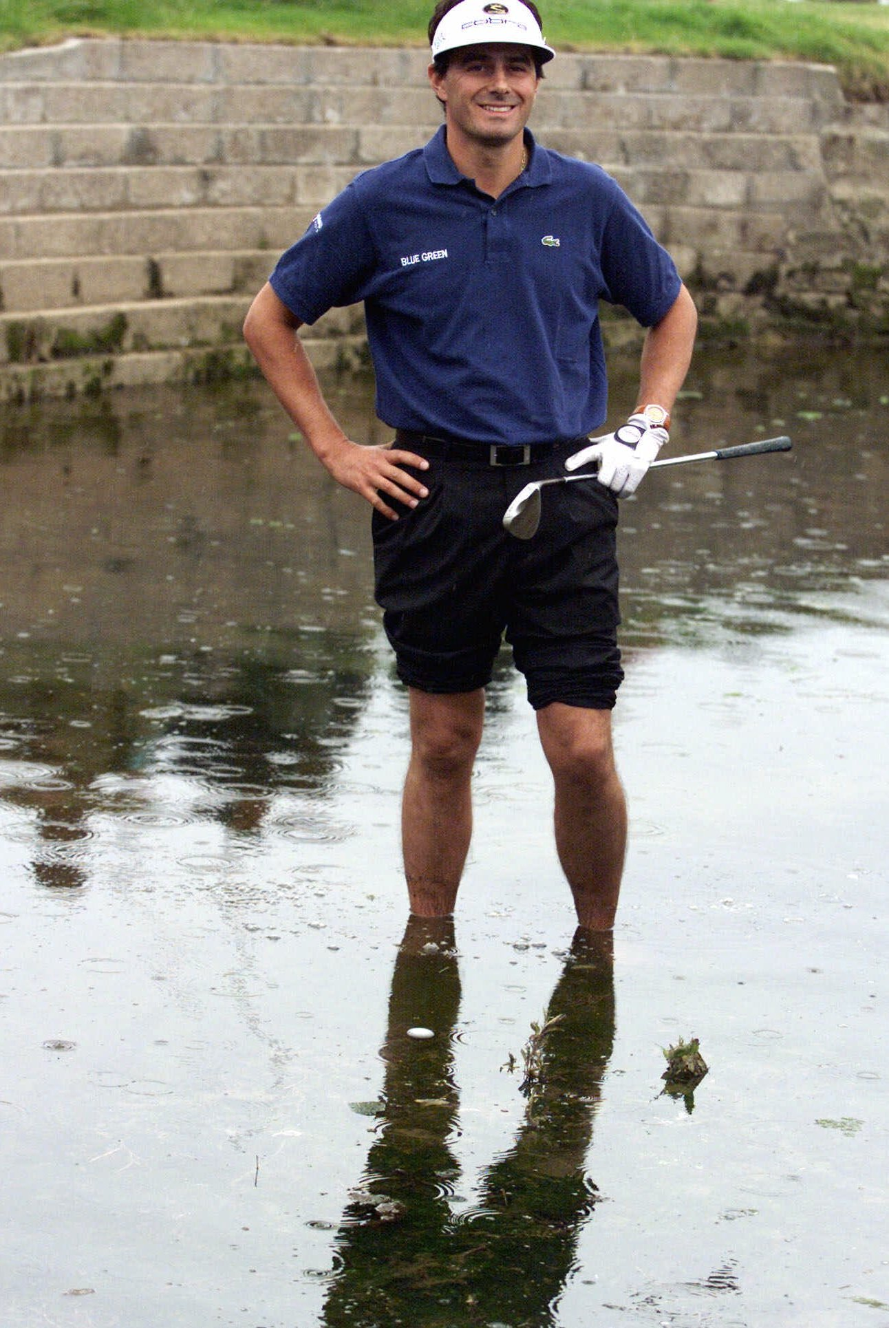 FILE - In this July 18, 1999, file photo, France's Jean Van de Velde smiles as he stands in the water of the Barry Burn that crosses the 18th fairway to see if his ball, bottom center, was playable during the final round of the 128th British Open Golf Cha