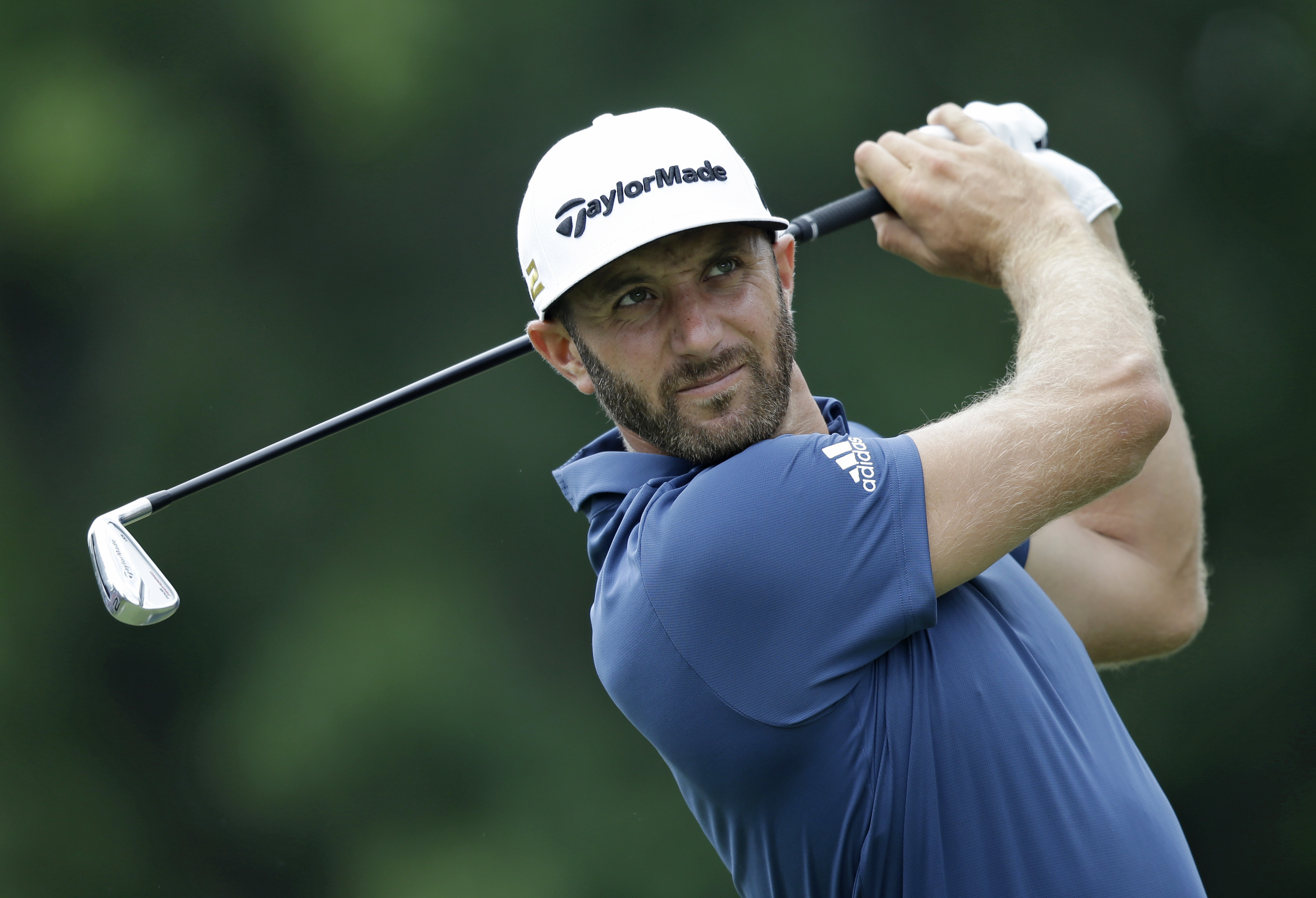 FILE - In this July 1, 2016, file photo, Dustin Johnson tees off on the third hole during the second round of the Bridgestone Invitational golf tournament at Firestone Country Club in Akron, Ohio. The British Open is scheduled for July 1417, 2016, at Roya