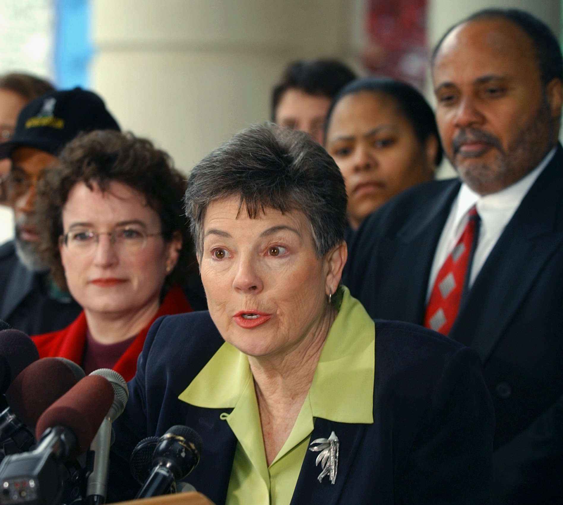 FILE - In this April 10, 2003, file photo, Martha Burk, center, chair of the National Council of Women's Organizations, speaks to media in Atlanta. Burk is back in golf, encouraging people to join a protest over the U.S. Women's Open being held next year