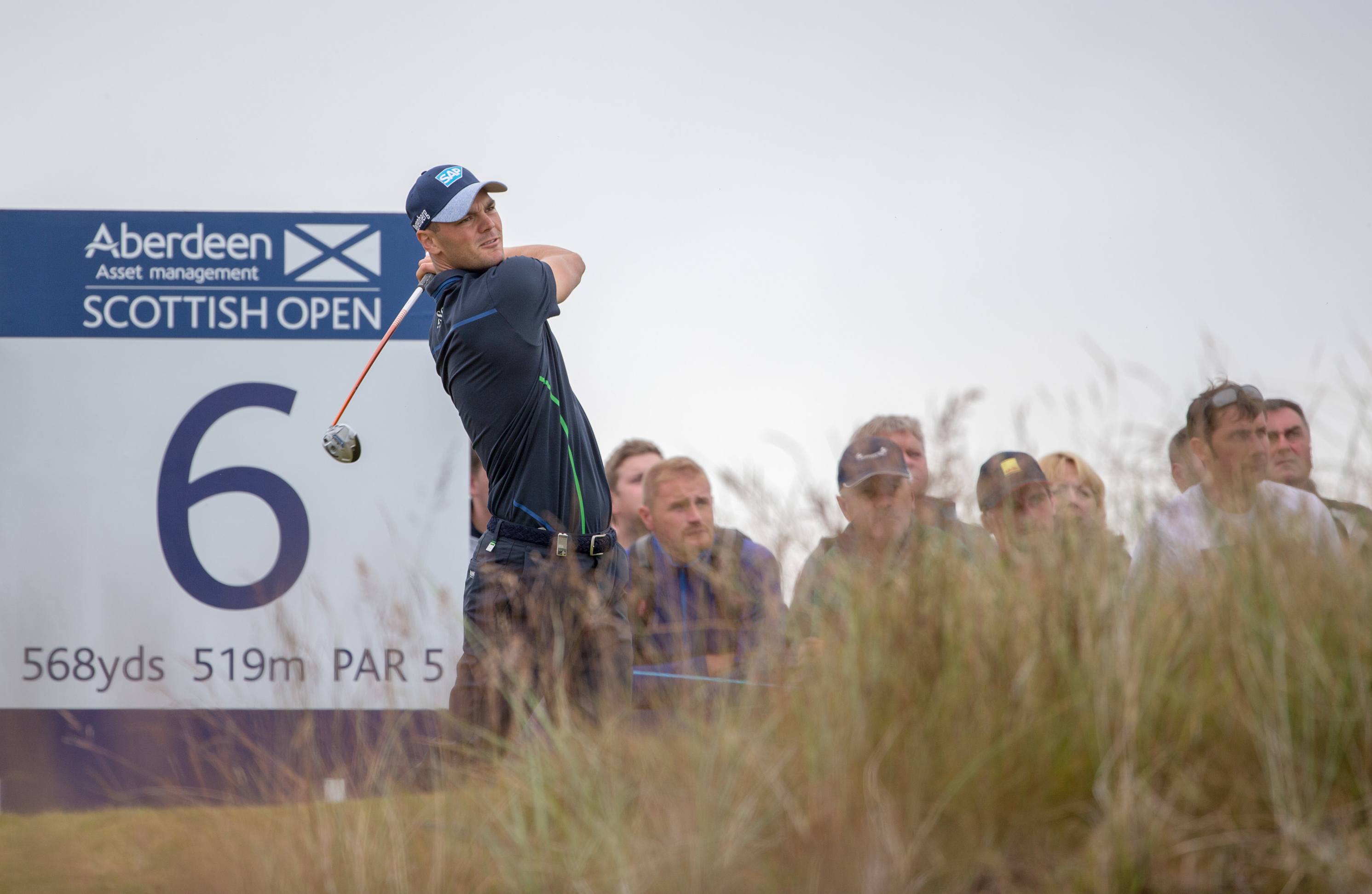 Germany's Martin Kaymer tees off on the 6th, during day three of the 2016 AAM Scottish Open golf tournament at Castle Stuart Golf Links in Inverness, Scotland, Saturday July 9, 2016. (Kenny Smith / PA via AP)