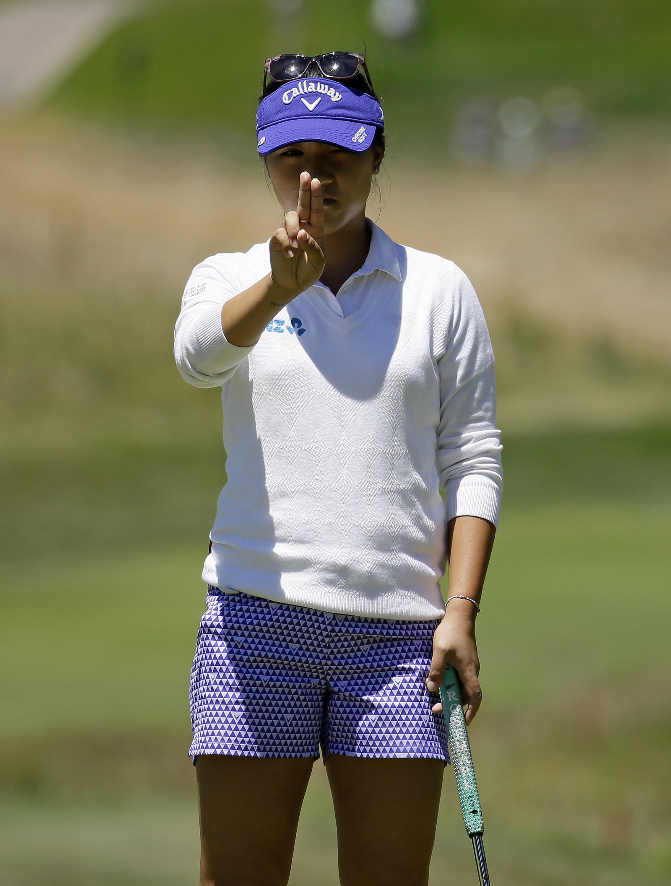 Lydia Ko, of New Zealand, lines up her putt on the sixth green during the final round of the U.S. Women's Open golf tournament at CordeValle, Sunday, July 10, 2016, in San Martin, Calif. (AP Photo/Eric Risberg)