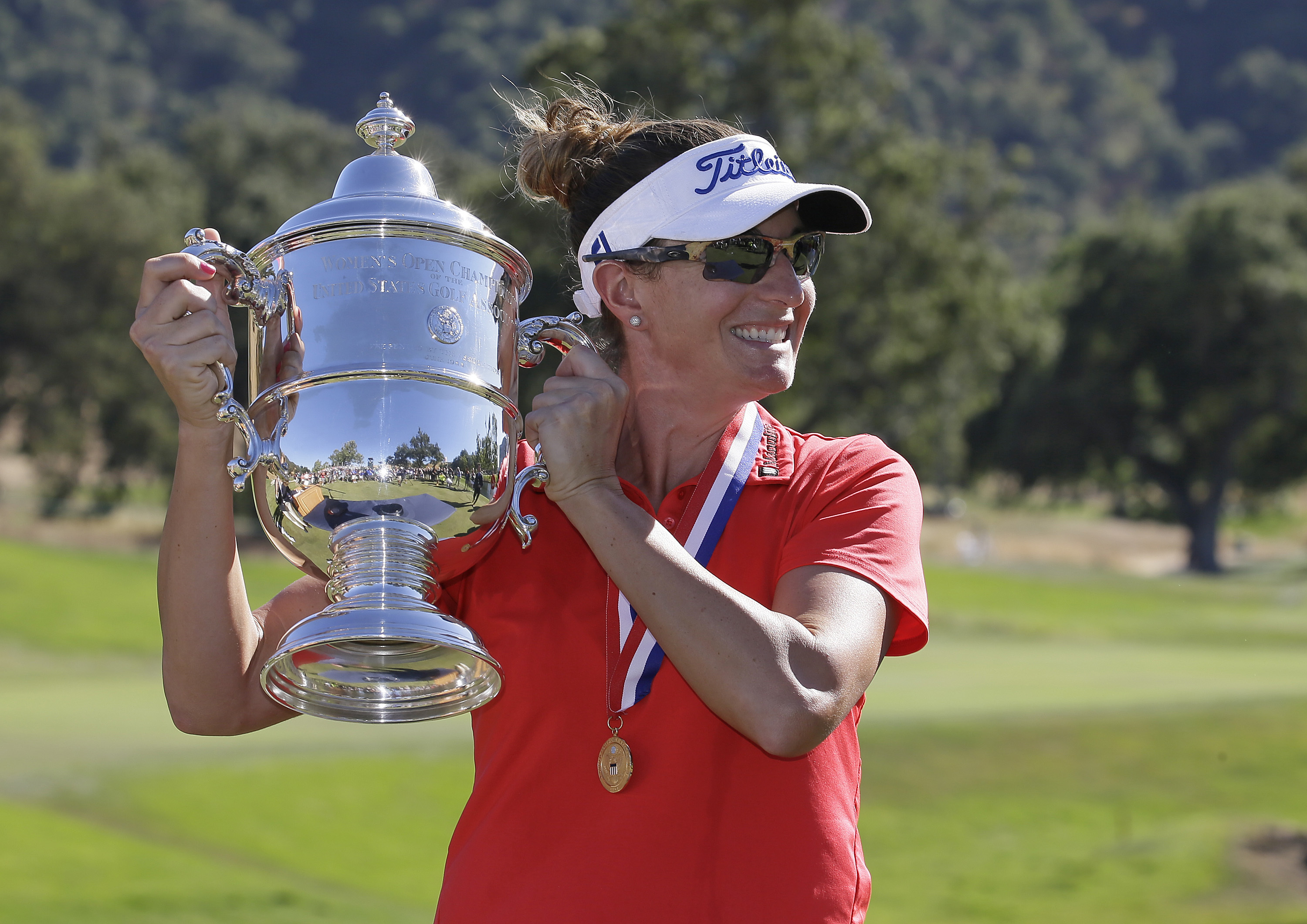 Brittany Lang holds up her trophy on the 18th green after winning the U.S. Women's Open golf tournament at CordeValle, Sunday, July 10, 2016, in San Martin, Calif. (AP Photo/Eric Risberg)
