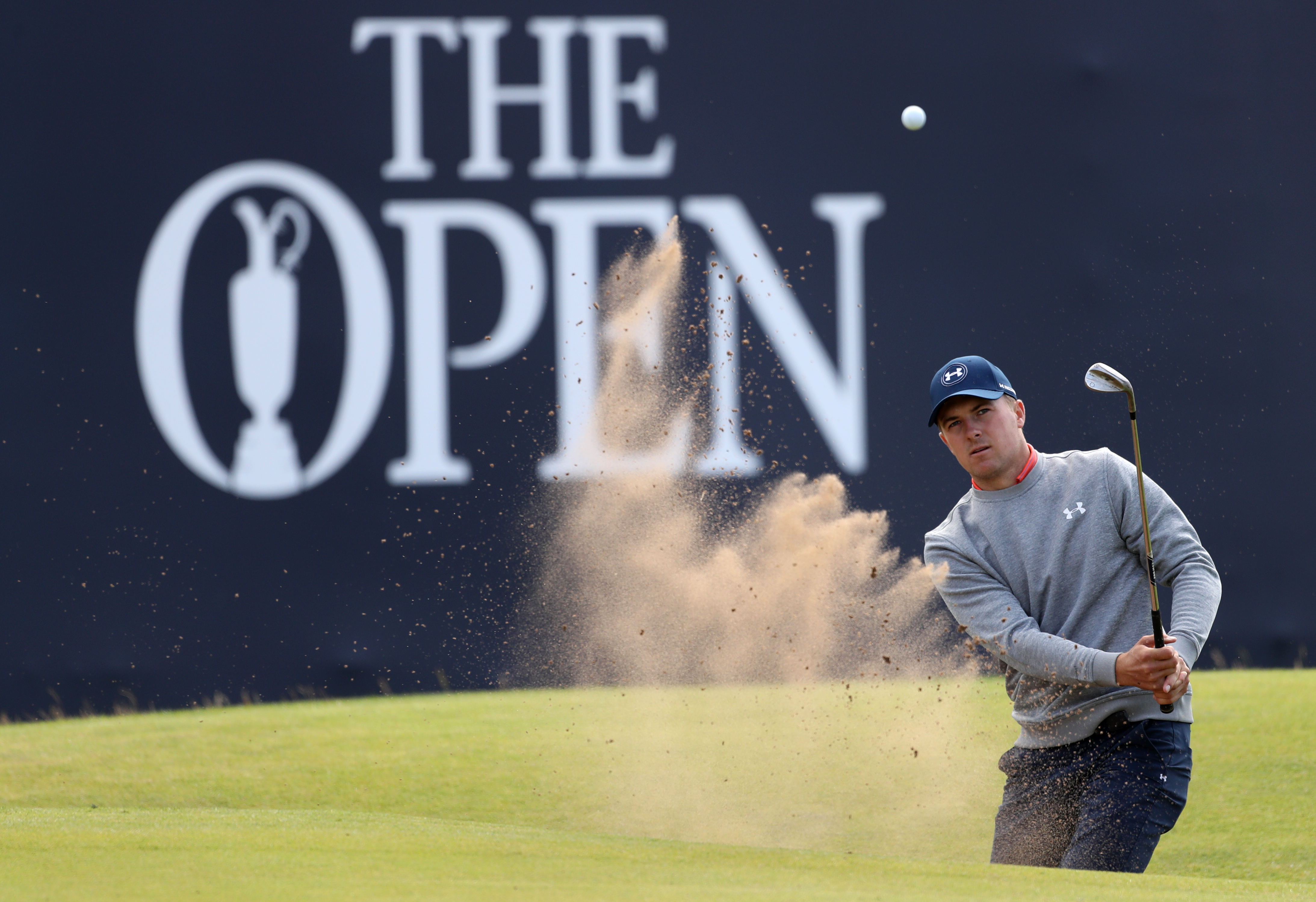Jordan Spieth of the United States plays out of a sand trap on the 18th green during a practice round ahead of the British Open Golf Championship at the Royal Troon Golf Club in Troon, Scotland, Wednesday, July 13, 2016. The British Open starts Thursday.(