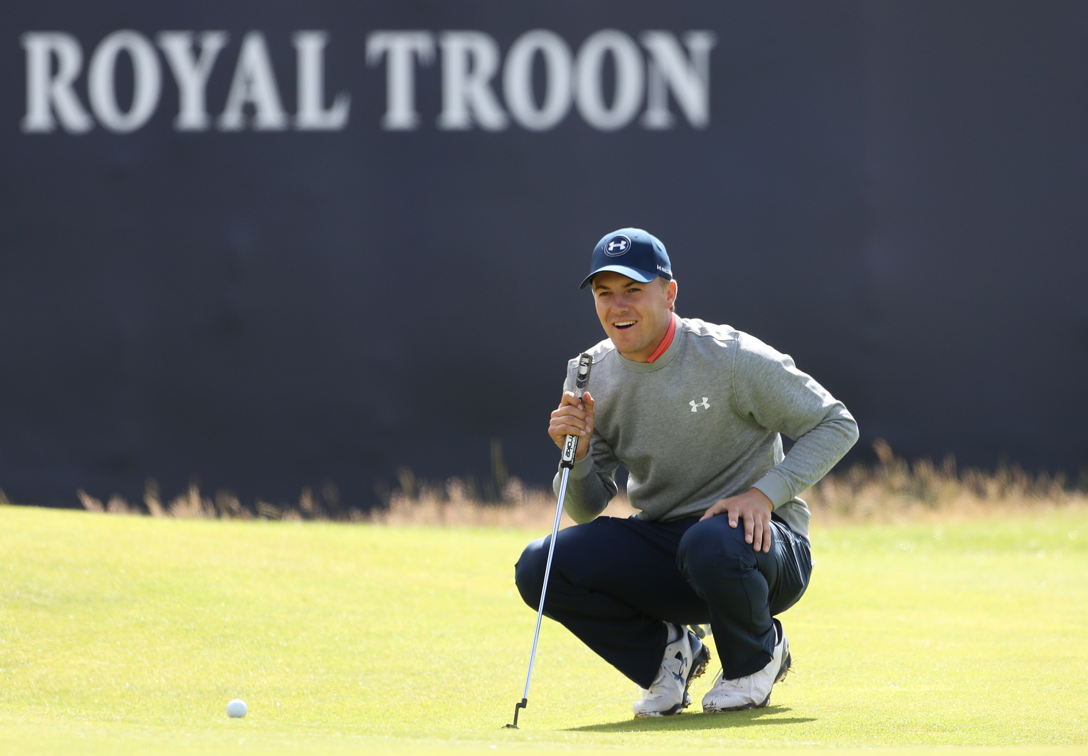 Jordan Spieth of the United States smiles as he look at his putt on the 18th green during a practice round ahead of the British Open Golf Championship at the Royal Troon Golf Club in Troon, Scotland, Wednesday, July 13, 2016. The British Open starts Thurs