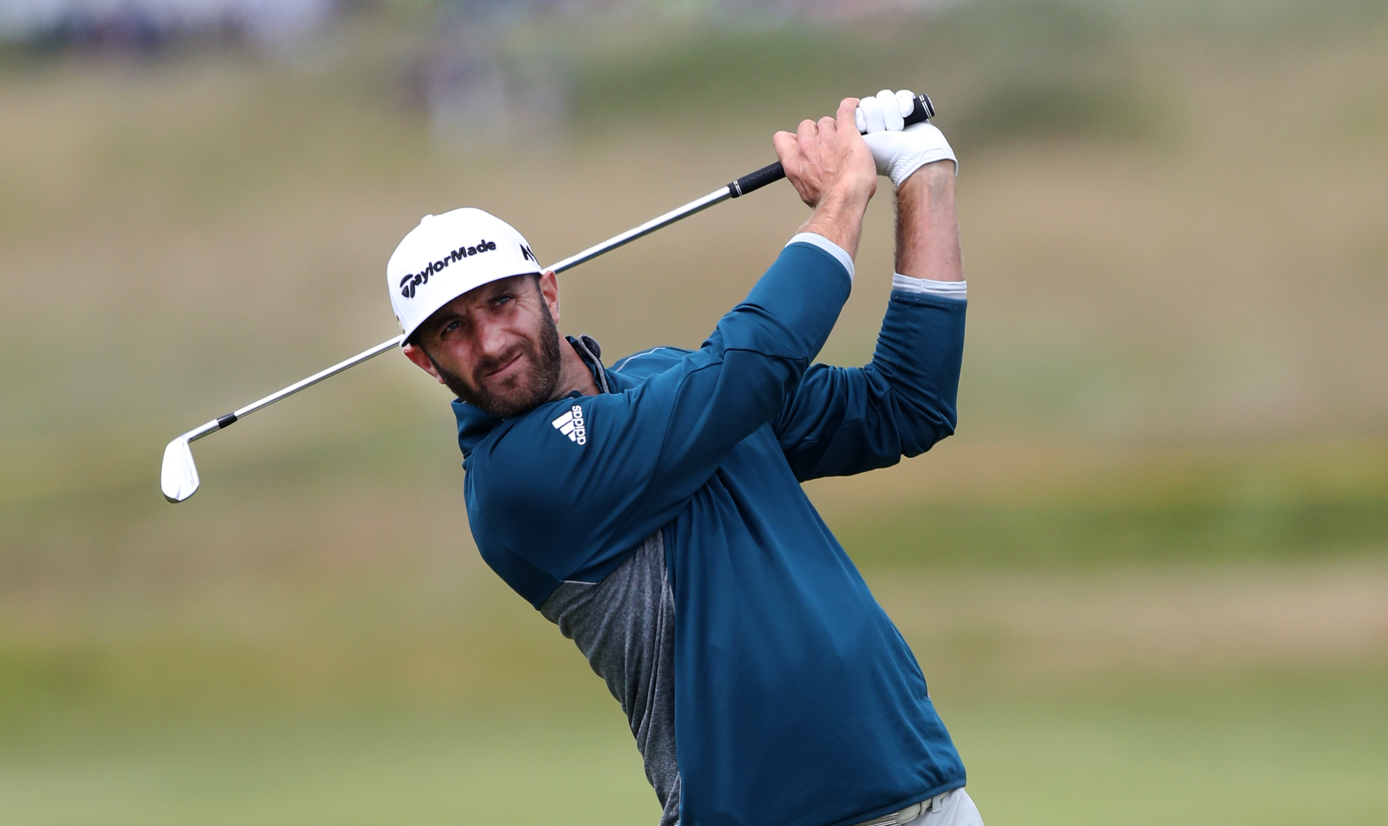 Dustin Johnson of the United States plays a shot from the 4th fairway during a practice round ahead of the British Open Golf Championship at the Royal Troon Golf Club in Troon, Scotland, Wednesday, July 13, 2016. The British Open starts Thursday.(AP Photo
