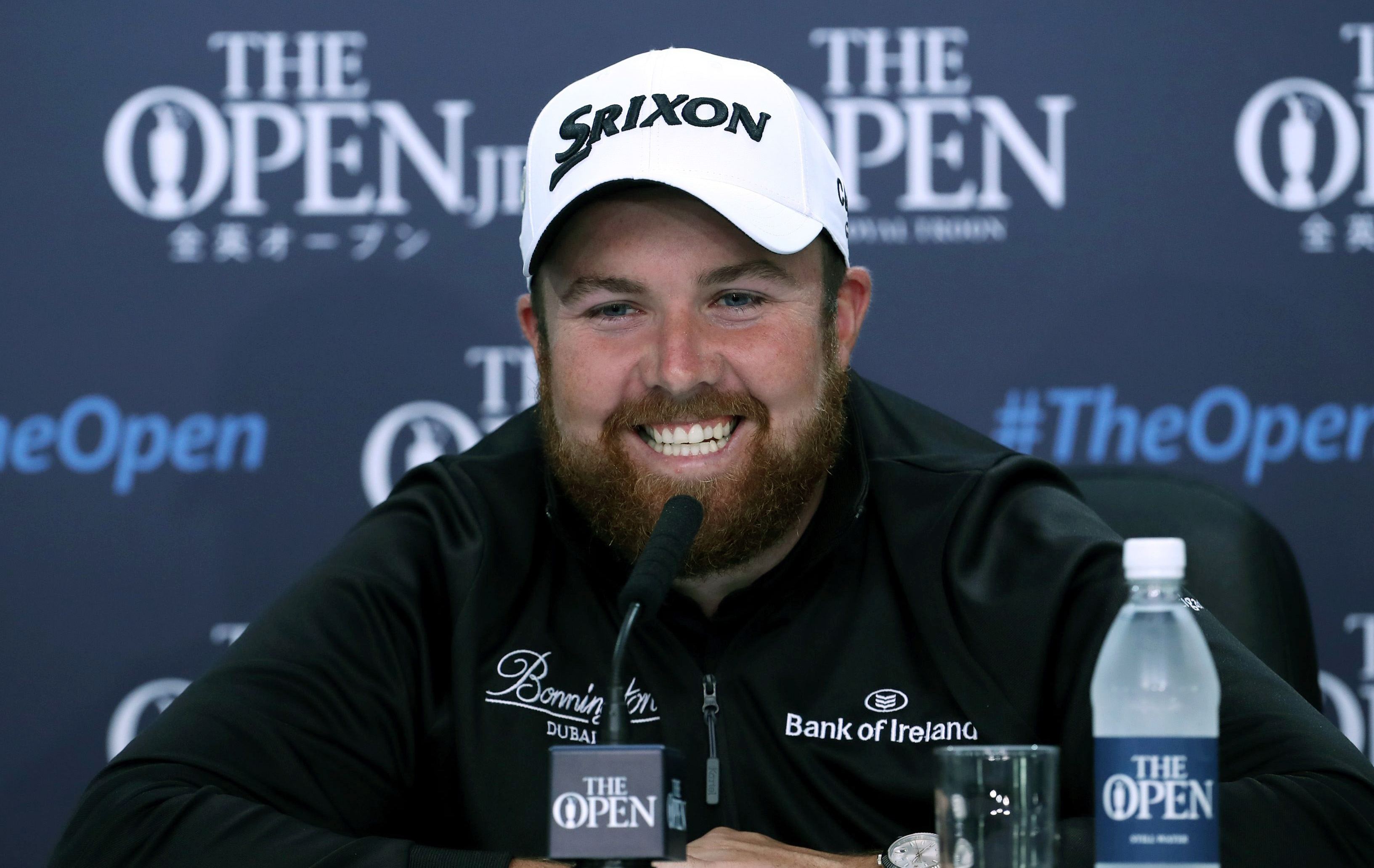 Ireland's Shane Lowry smiles during a press conference listens to a question during a press conference ahead of the British Open Golf Championships at the Royal Troon Golf Club in Troon, Scotland, Wednesday, July 13, 2016. (Peter Byrne/PA via AP)