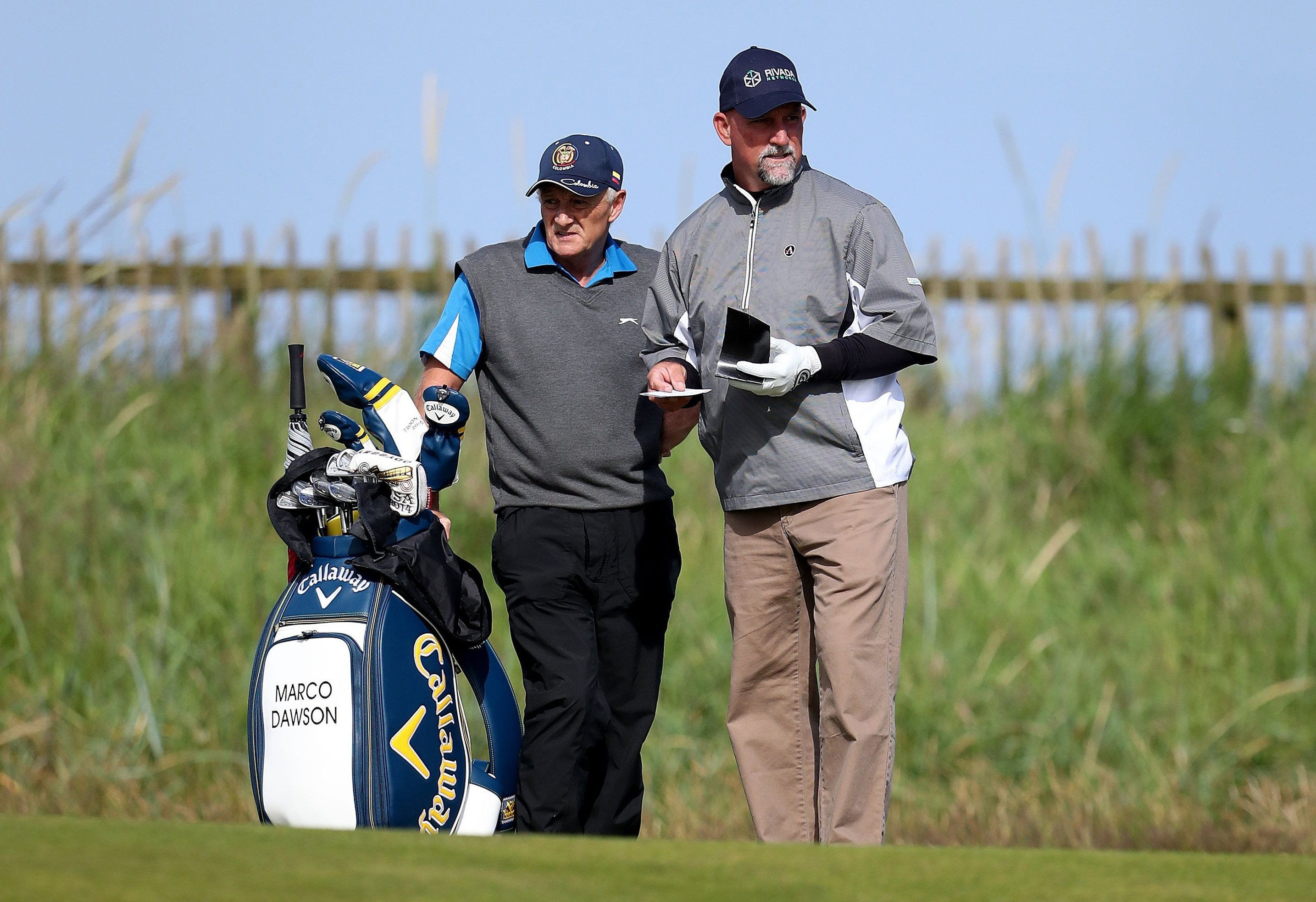 Marco Dawson of the U.S and his caddie William Ciplinski, left, during a practice round ahead of the British Open Golf Championships at the Royal Troon Golf Club in Troon, Scotland, Wednesday, July 13, 2016. Marco Dawson's caddie has been taken to hospita