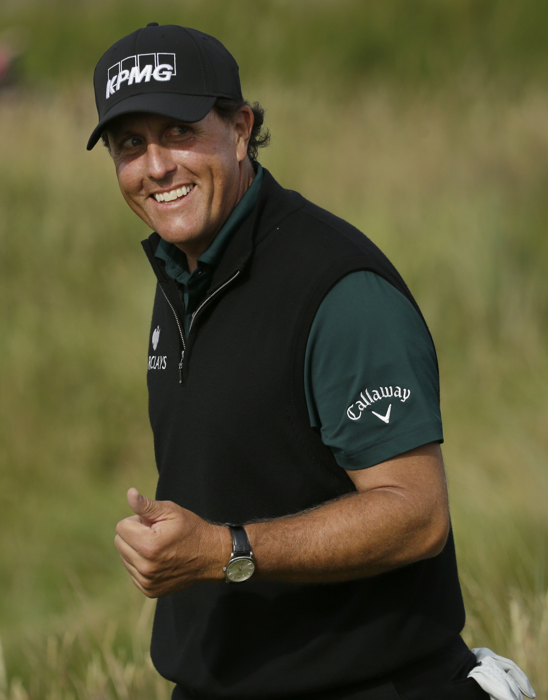 Phil Mickelson of the United States smiles as he walks down the 17th fairway during the first round of the British Open Golf Championship at the Royal Troon Golf Club in Troon, Scotland, Thursday, July 14, 2016. (AP Photo/Matt Dunham)