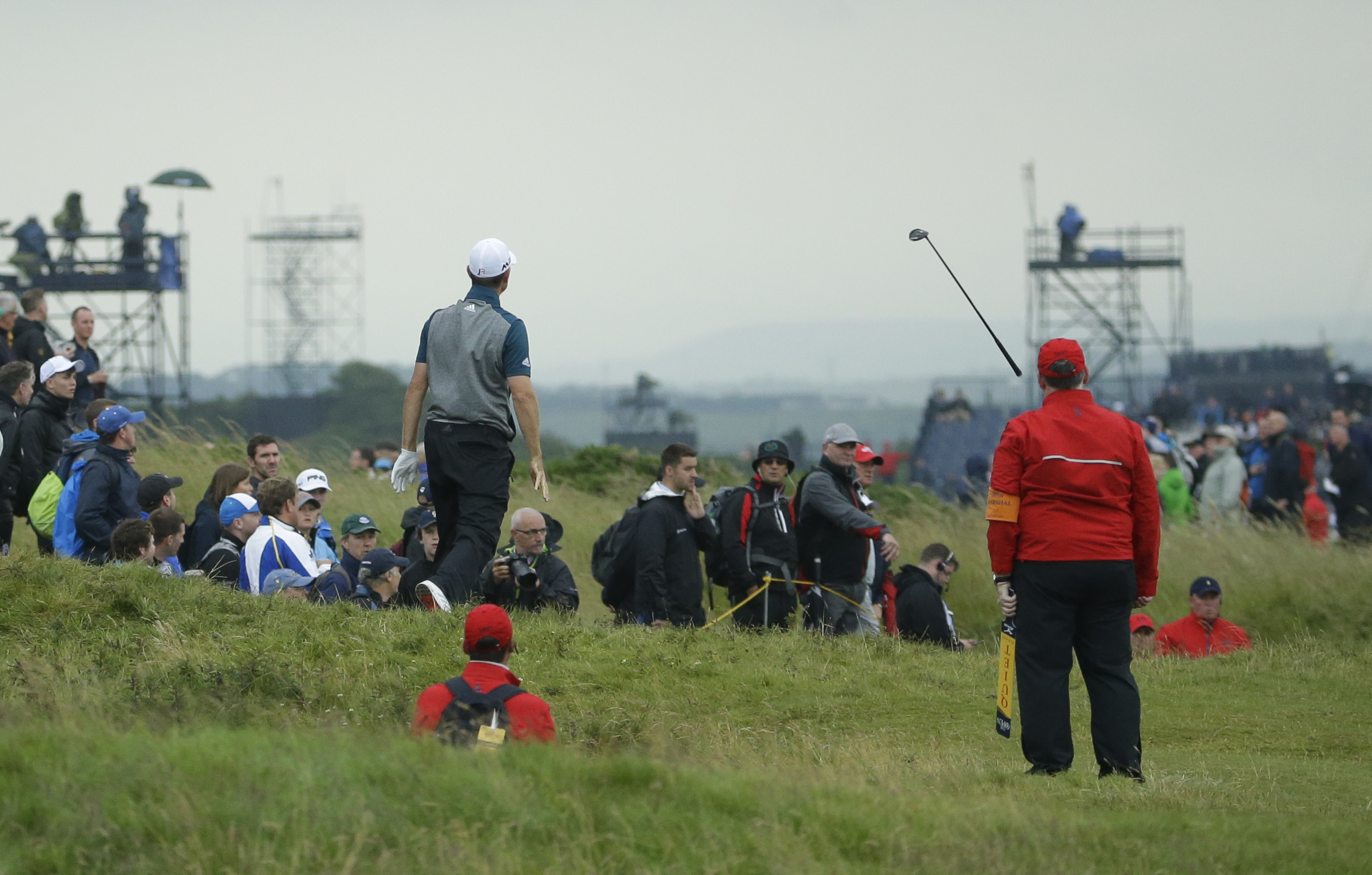 Justin Rose of England throws his club after a poor shot out of the rough on the 2nd hole during the second round of the British Open Golf Championship at the Royal Troon Golf Club in Troon, Scotland, Friday, July 15, 2016. (AP Photo/Matt Dunham)