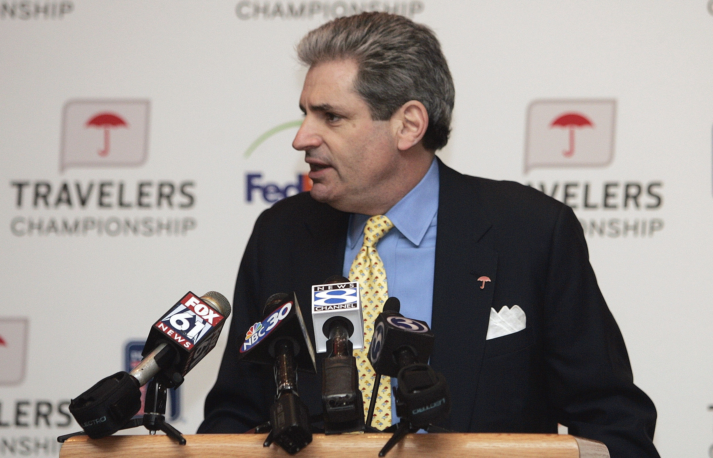 FILE - In this Feb. 13, 2009 file photo, Travelers chairman and CEO Jay Fishman speaks at a news conference in Hartford, Conn. A Connecticut medical center that specializes in the treatment and research of ALS has become the main beneficiary of The Travel